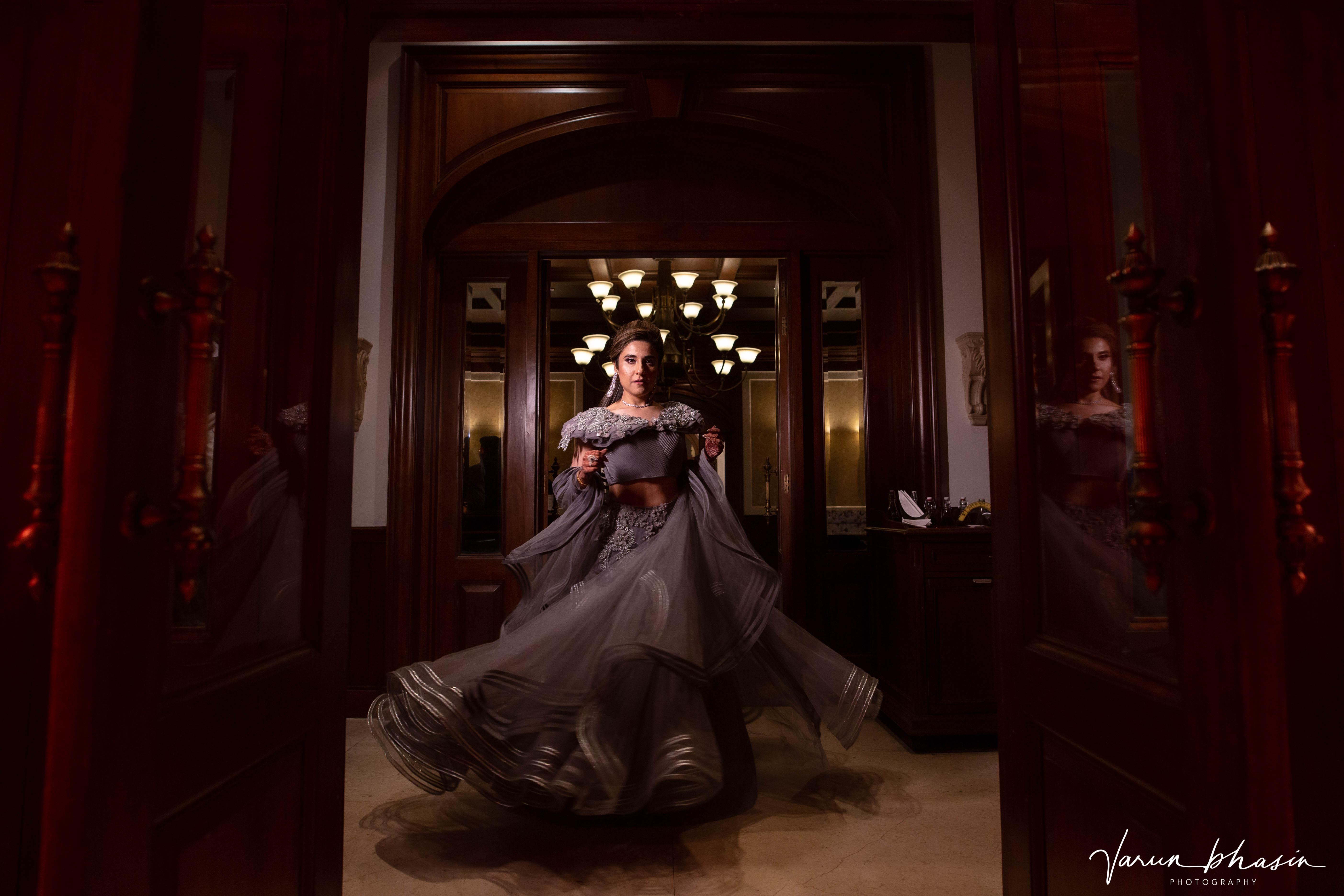 bride twirls in grey lehenga
