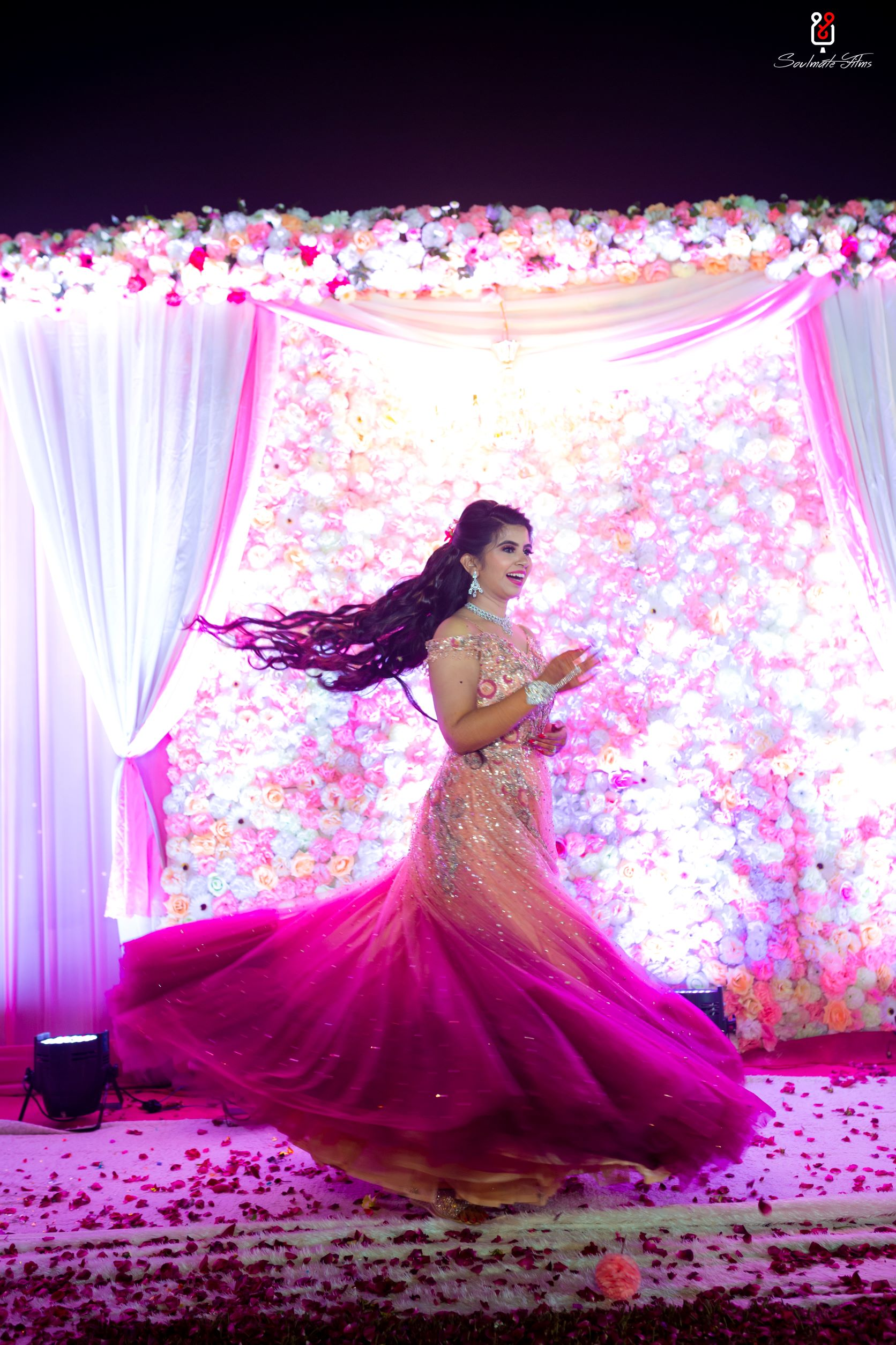 bride twirls in her ombre gown