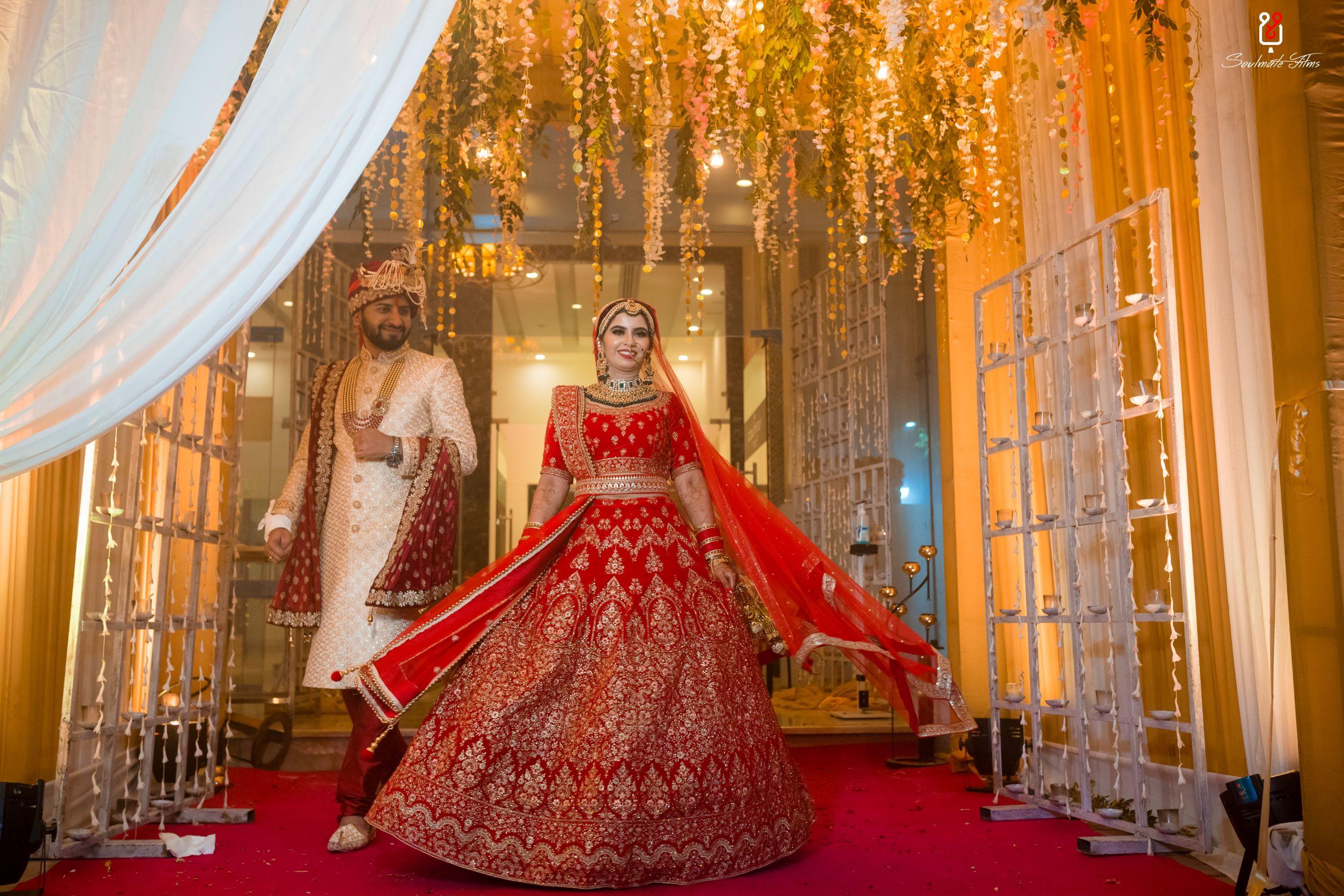 bride twirls in her red bridal lehenga