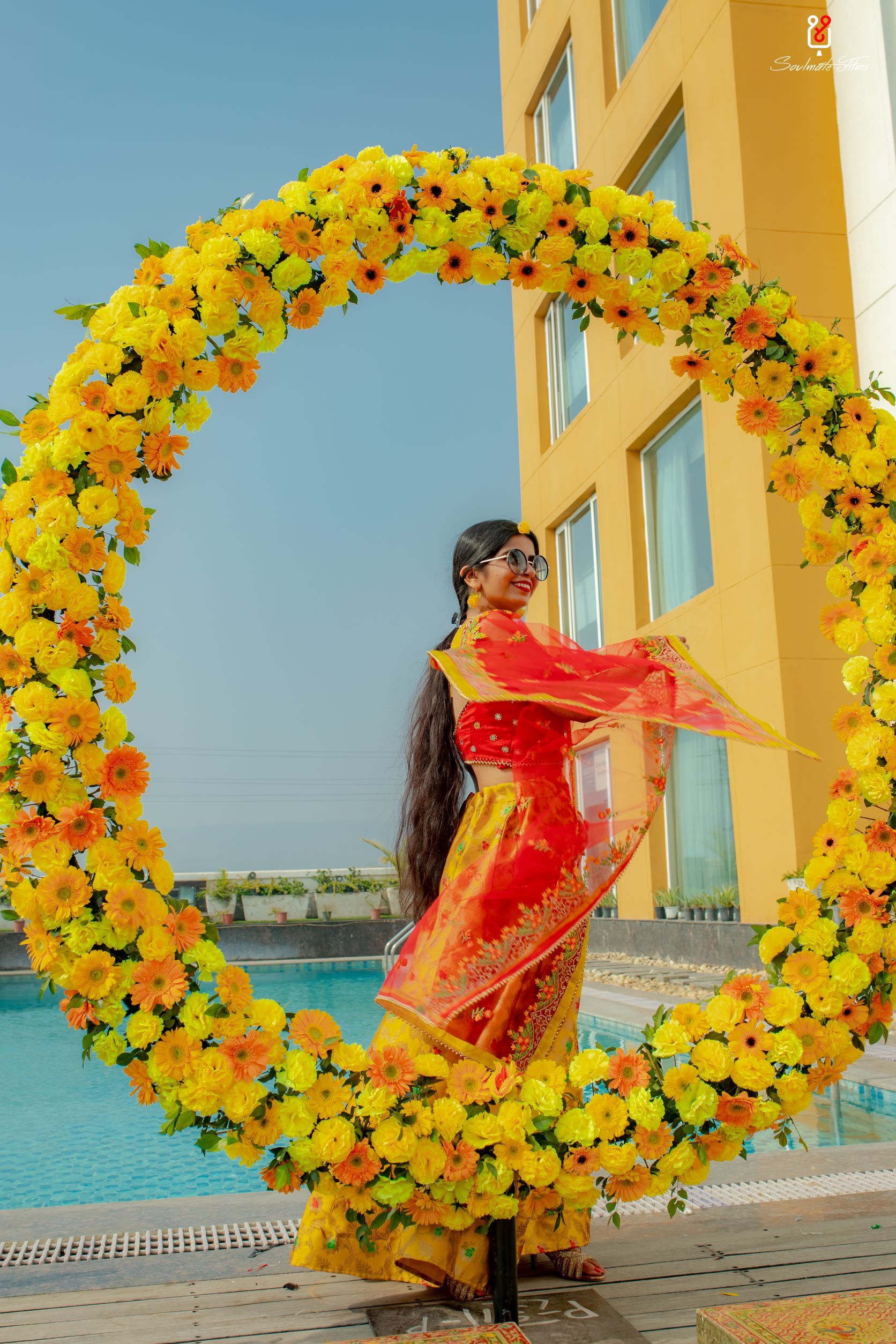 bride twirls in yellow lehenga for haldi