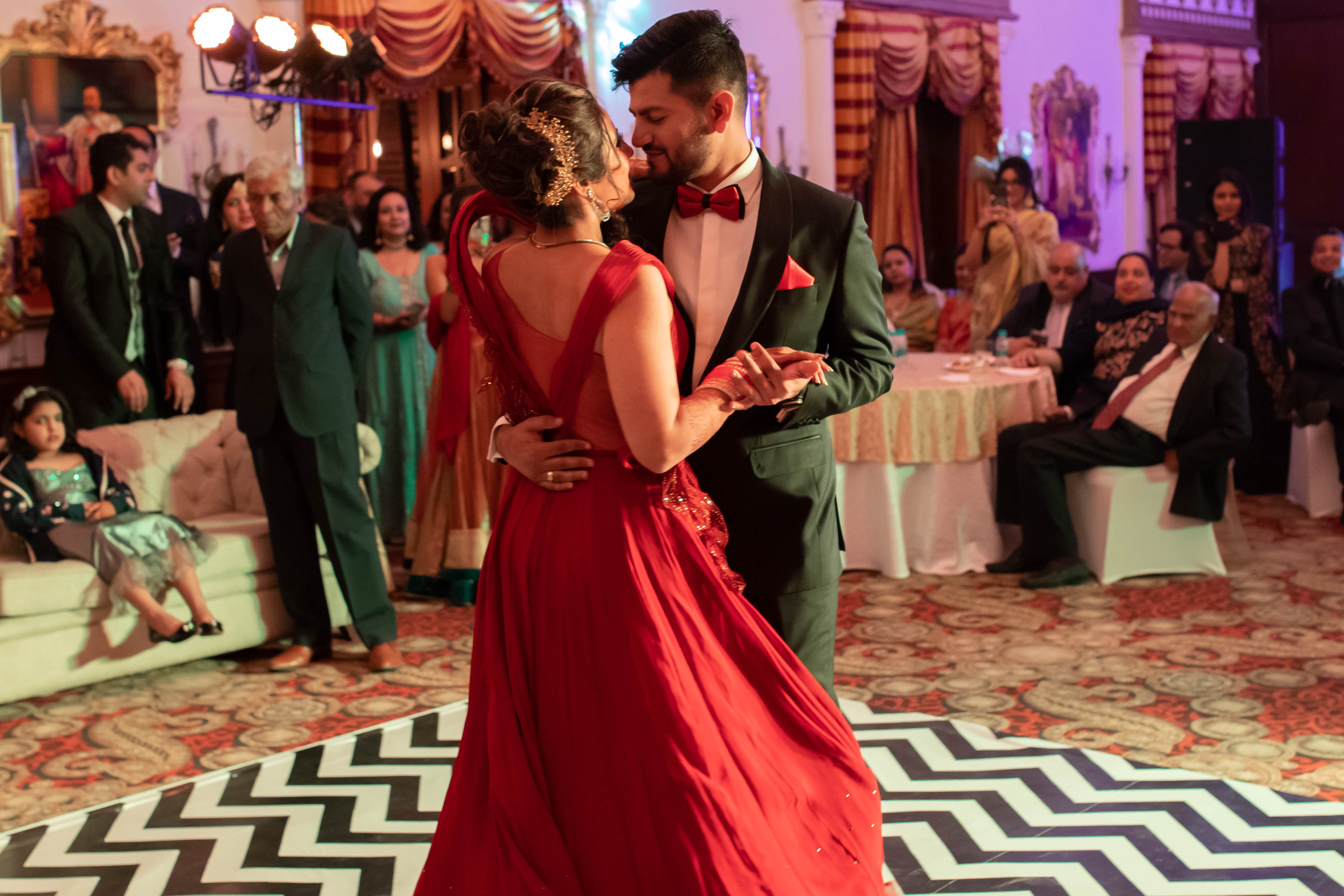 candid romantic shot of the couple dancing