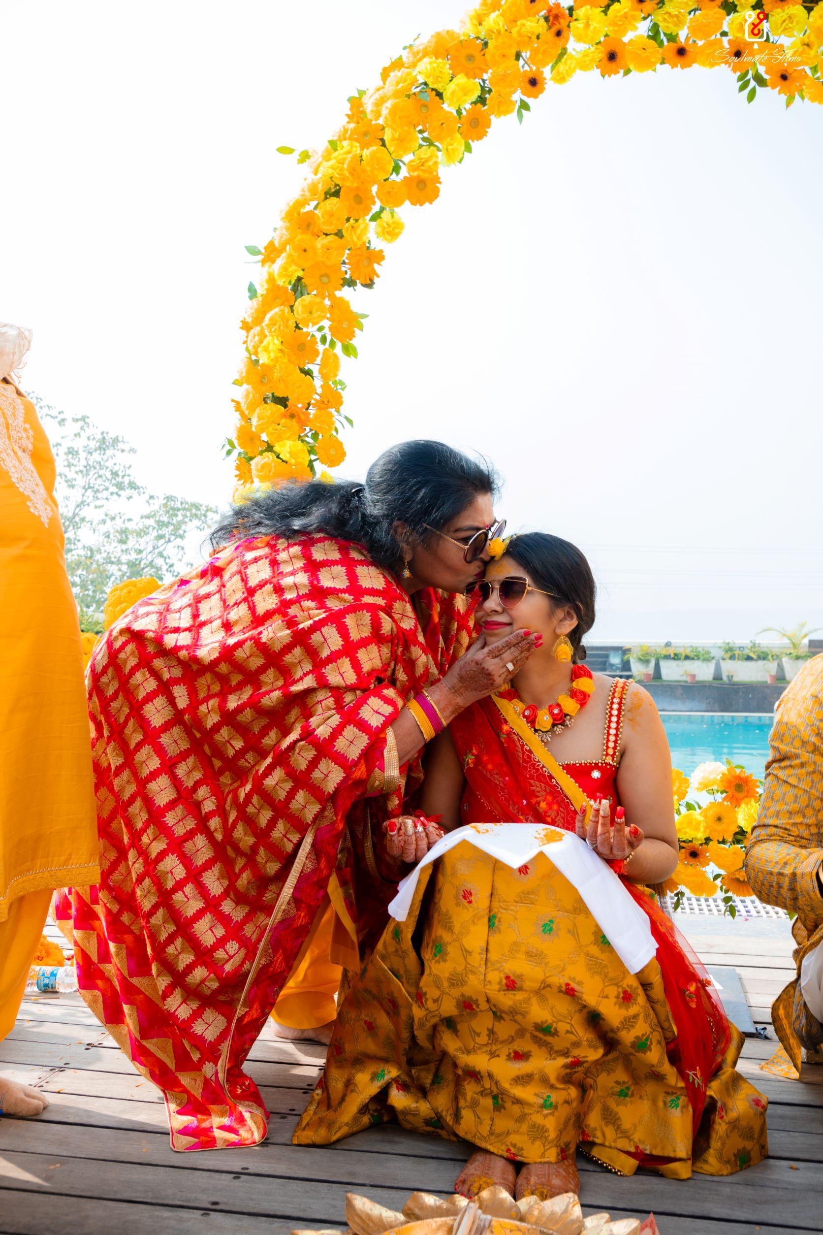 candid shot of the bride at her haldi
