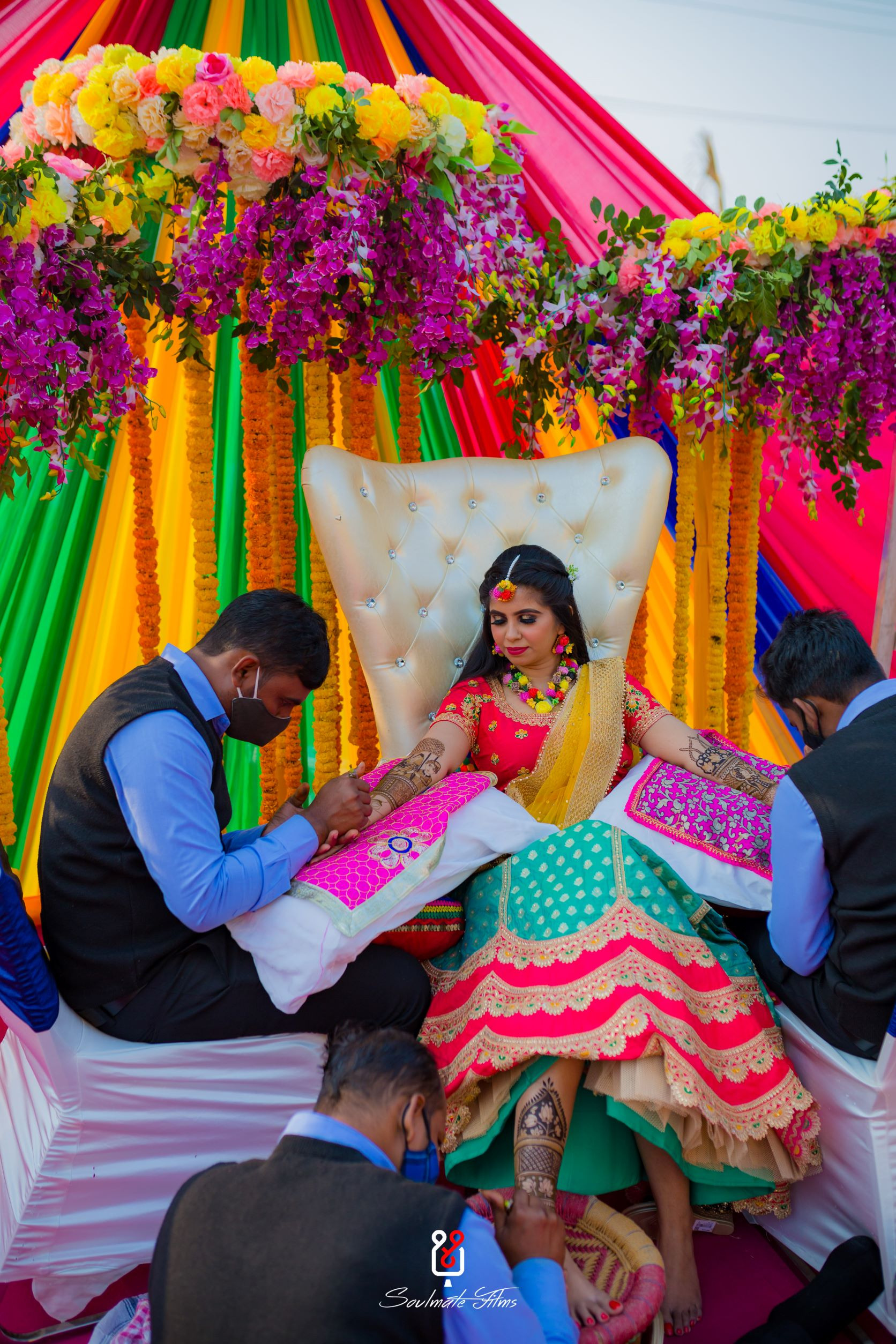candid shot of the bride getting her mehendi