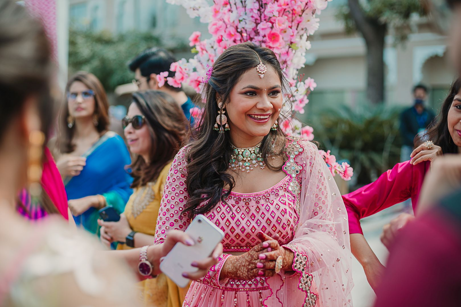 candid shot of the bride in pink