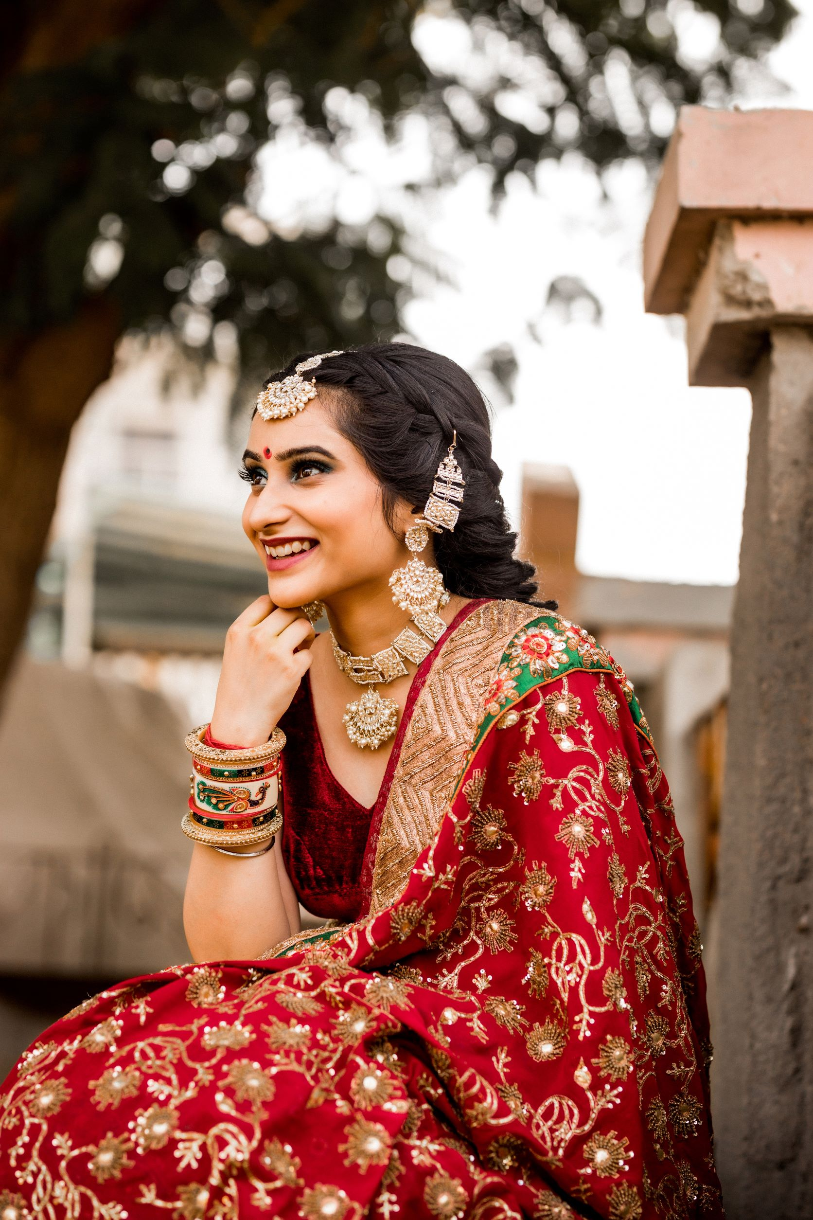 candid shot of the bride in red bridal lehenga