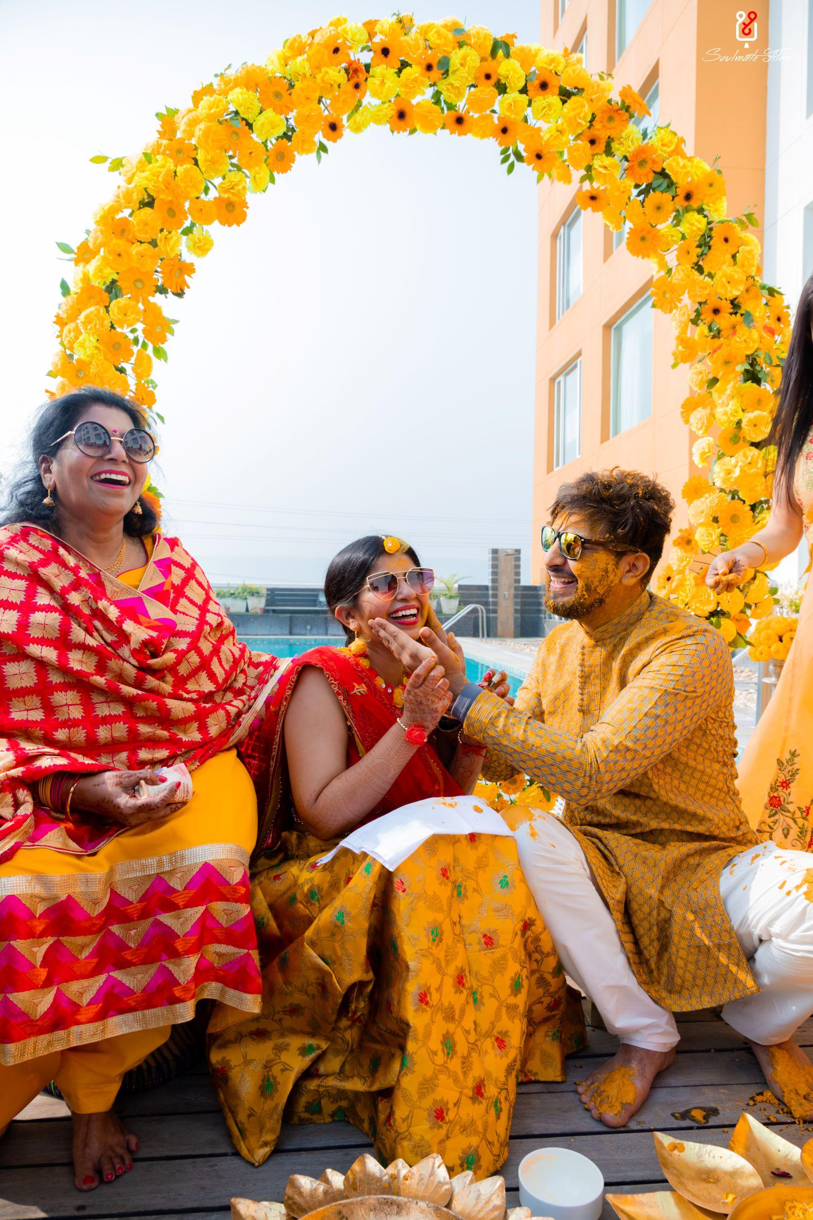 candid shot of the couple at their haldi