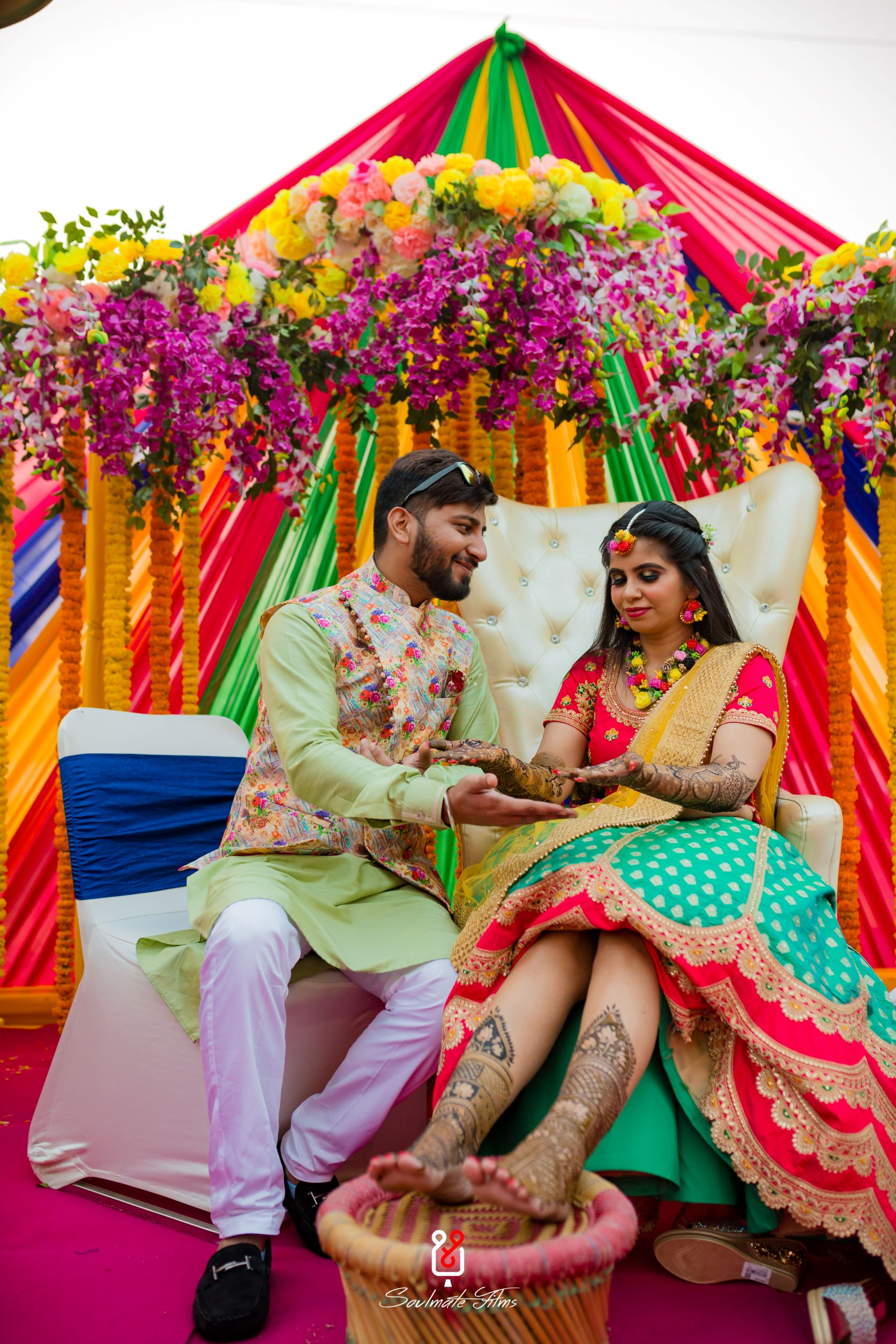 candid shot of the couple at their mehendi