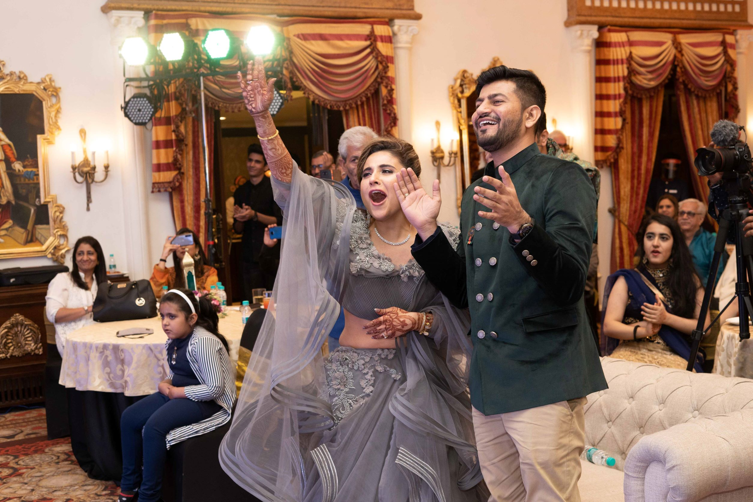 candid shot of the couple at their sangeet
