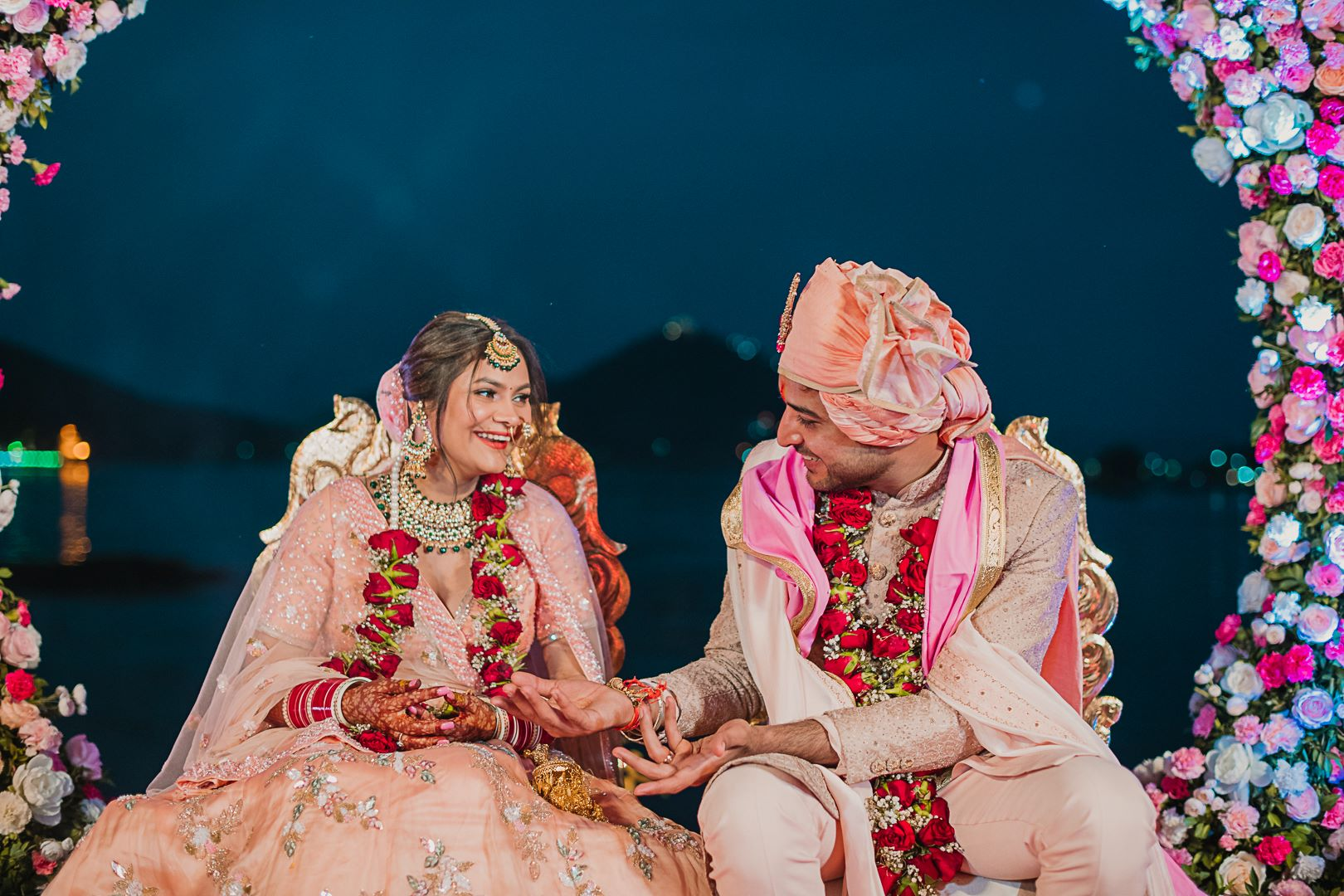 candid shot of the couple at their udaipur wedding
