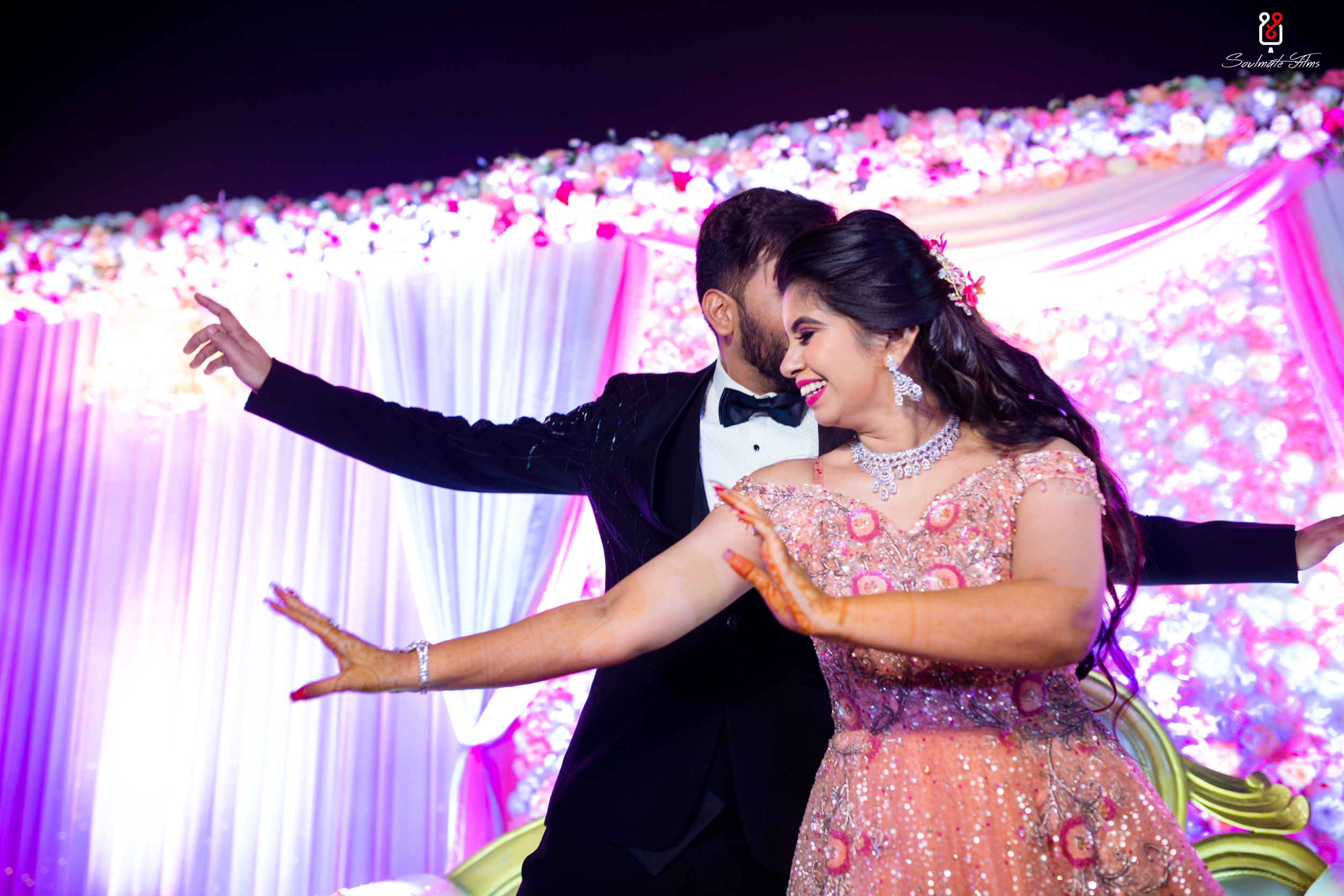 candid shot of the couple dancing