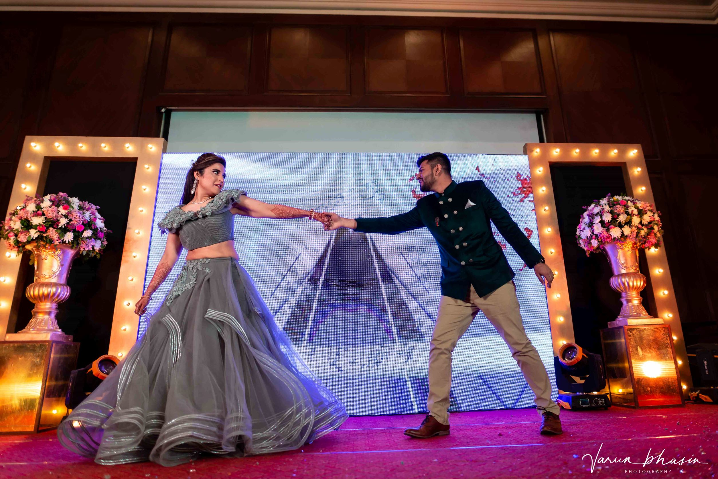 candid shot of the couple dancing at their sangeet
