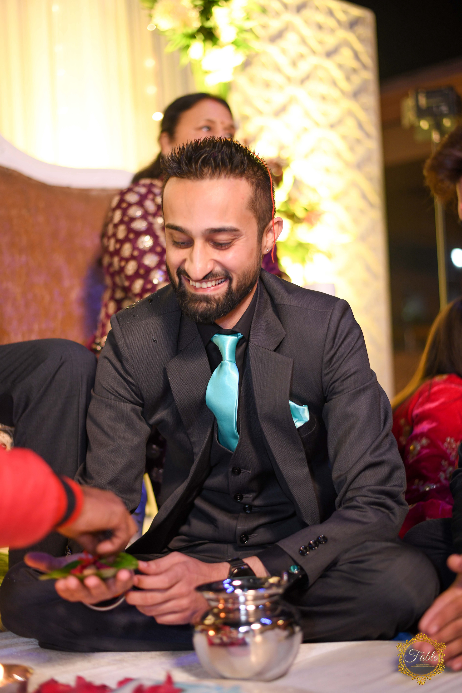 candid shot of the groom in black