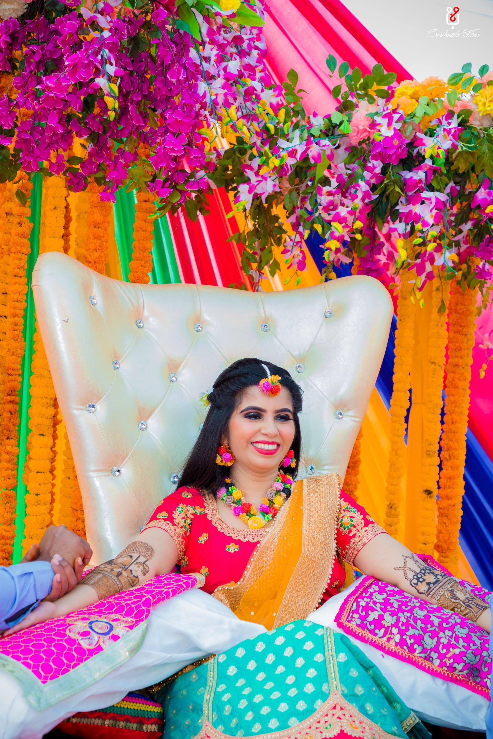 candid shot of the happy bride at her mehendi