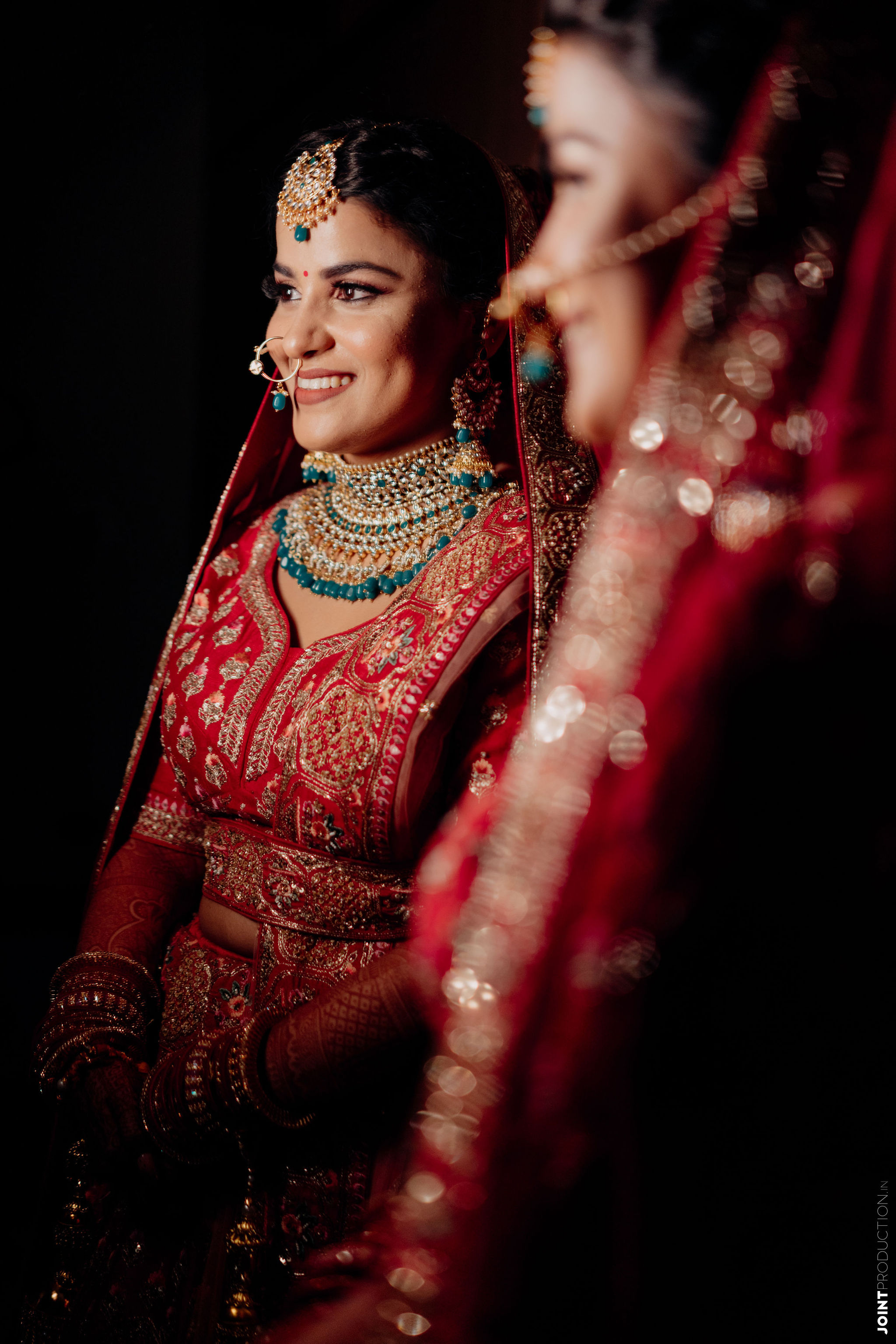 candid shot of the happy bride in red