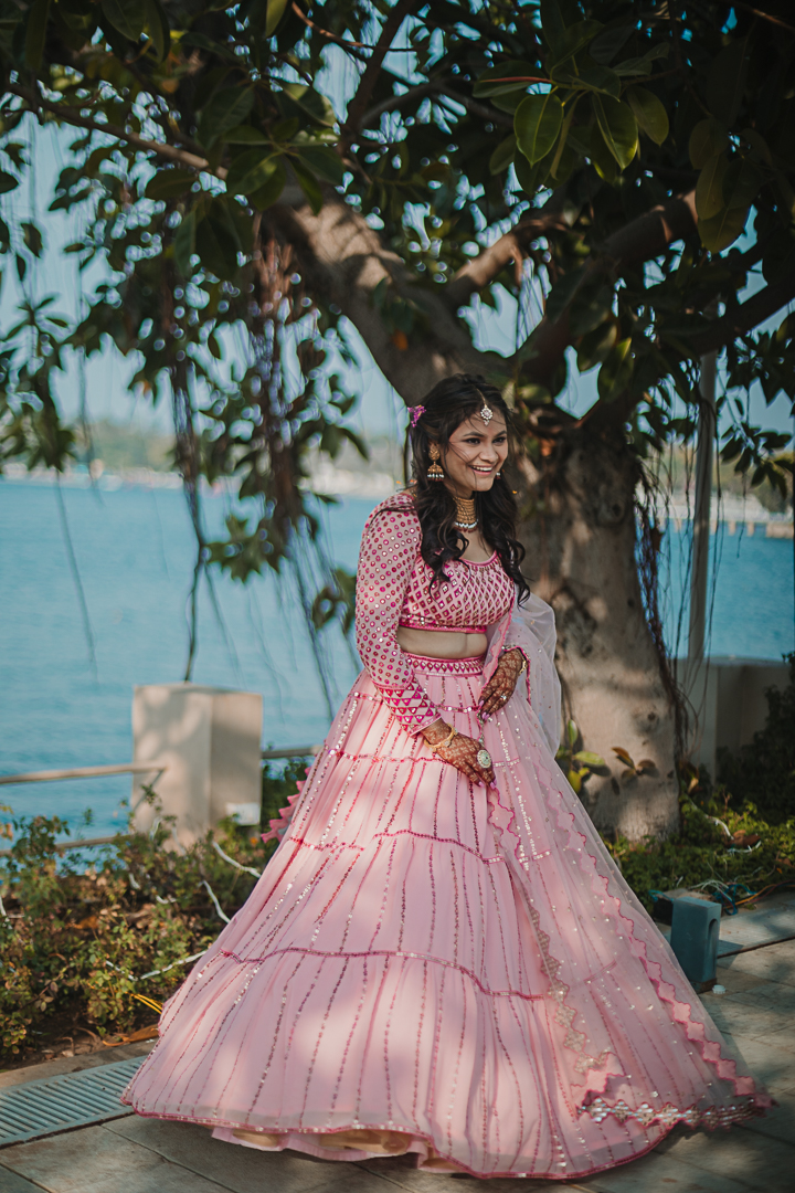 candid shot of the happy bride in udaipur