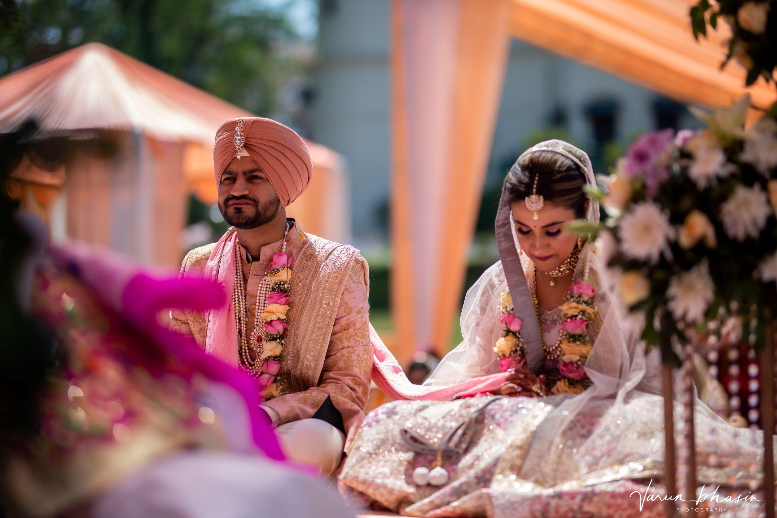 candid shot of the punjabi couple at their anand karaj