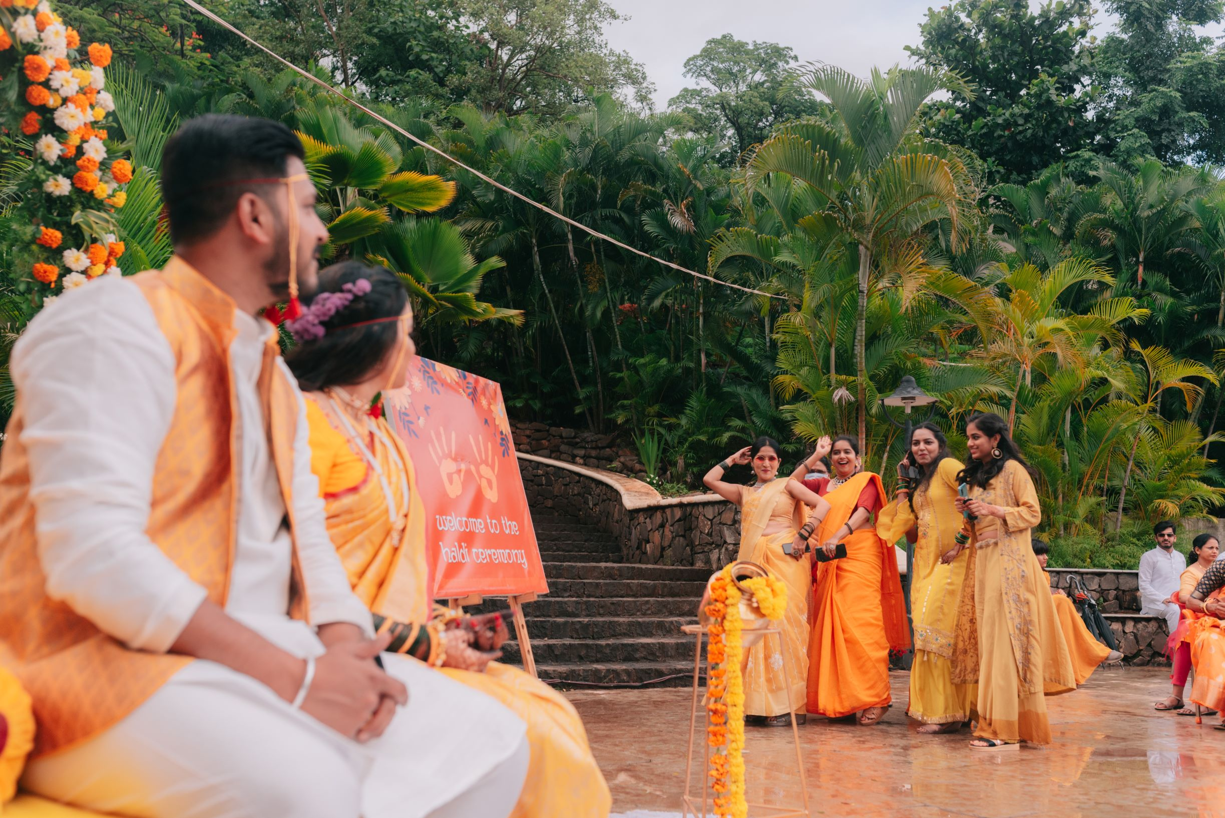 couple's family in yellow at their haldi