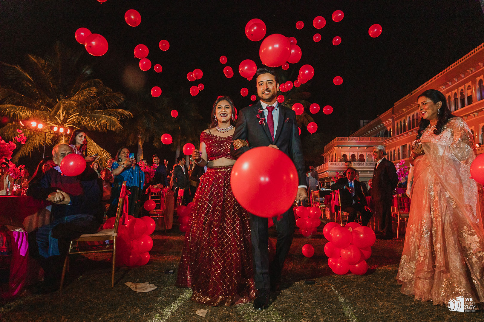 couple entry with red balloons