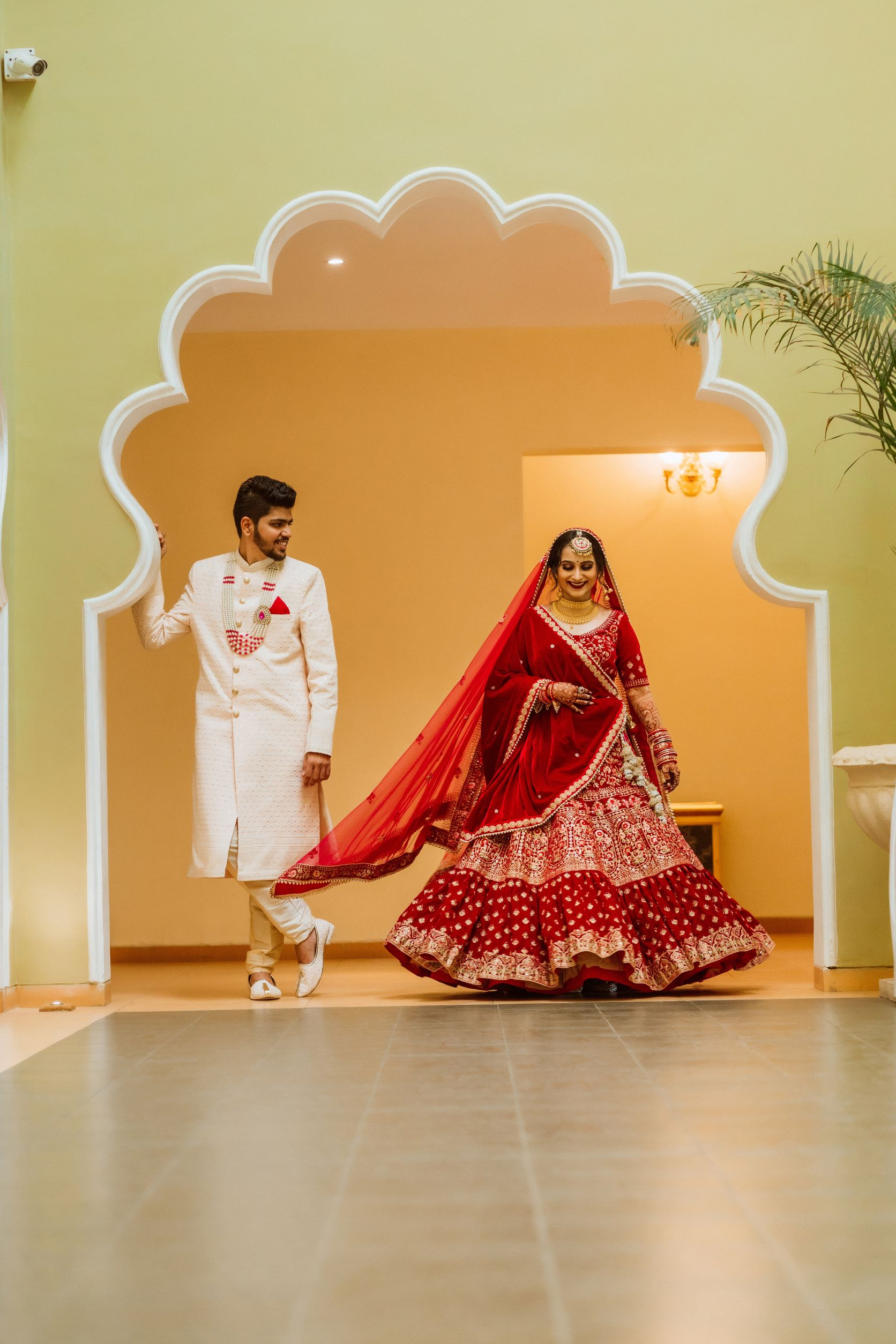 couple in contrasting outfits at their wedding