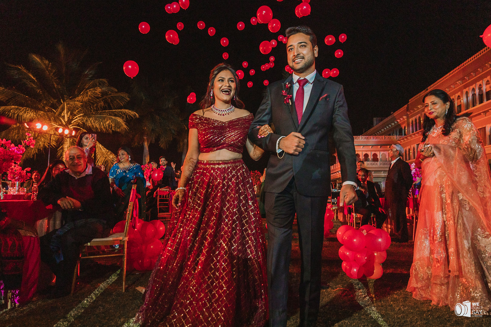 couple in contrasting red and black outfits