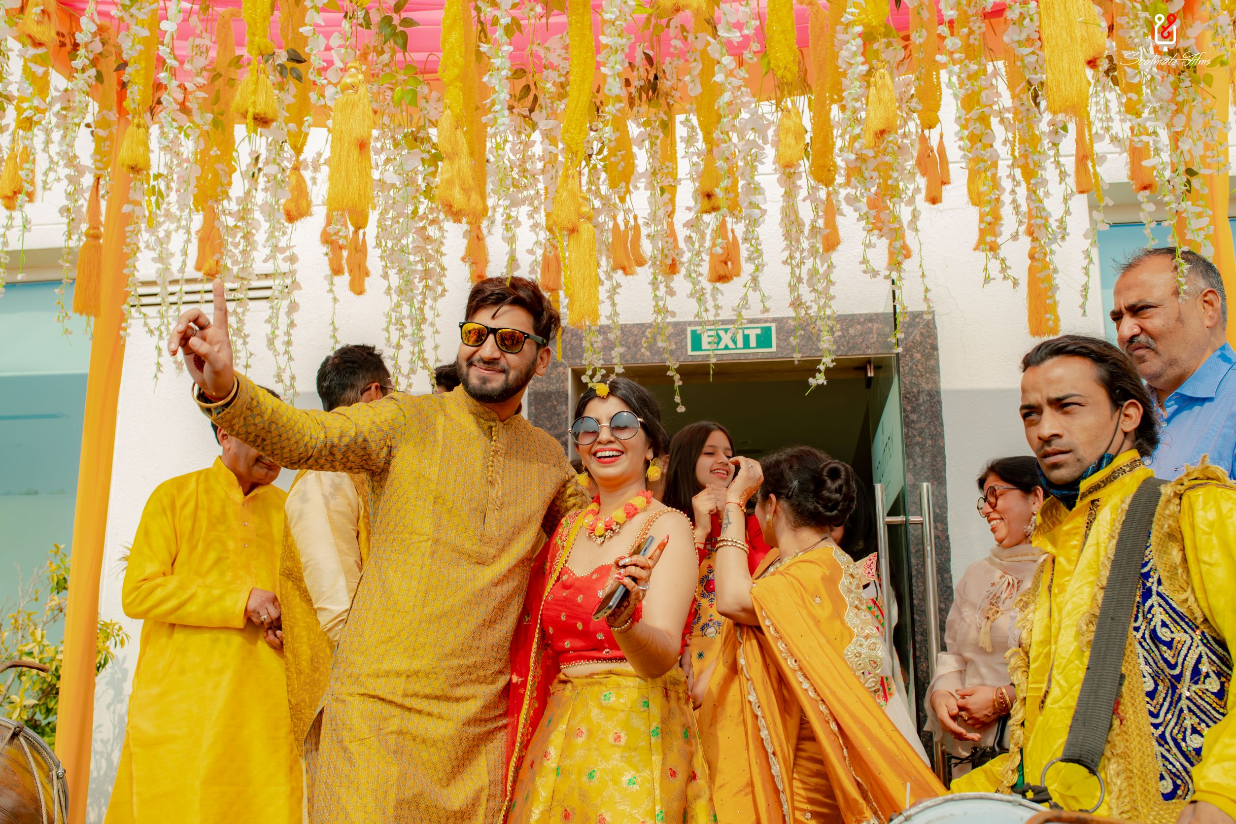 couple in yellow coordinated outfits for haldi