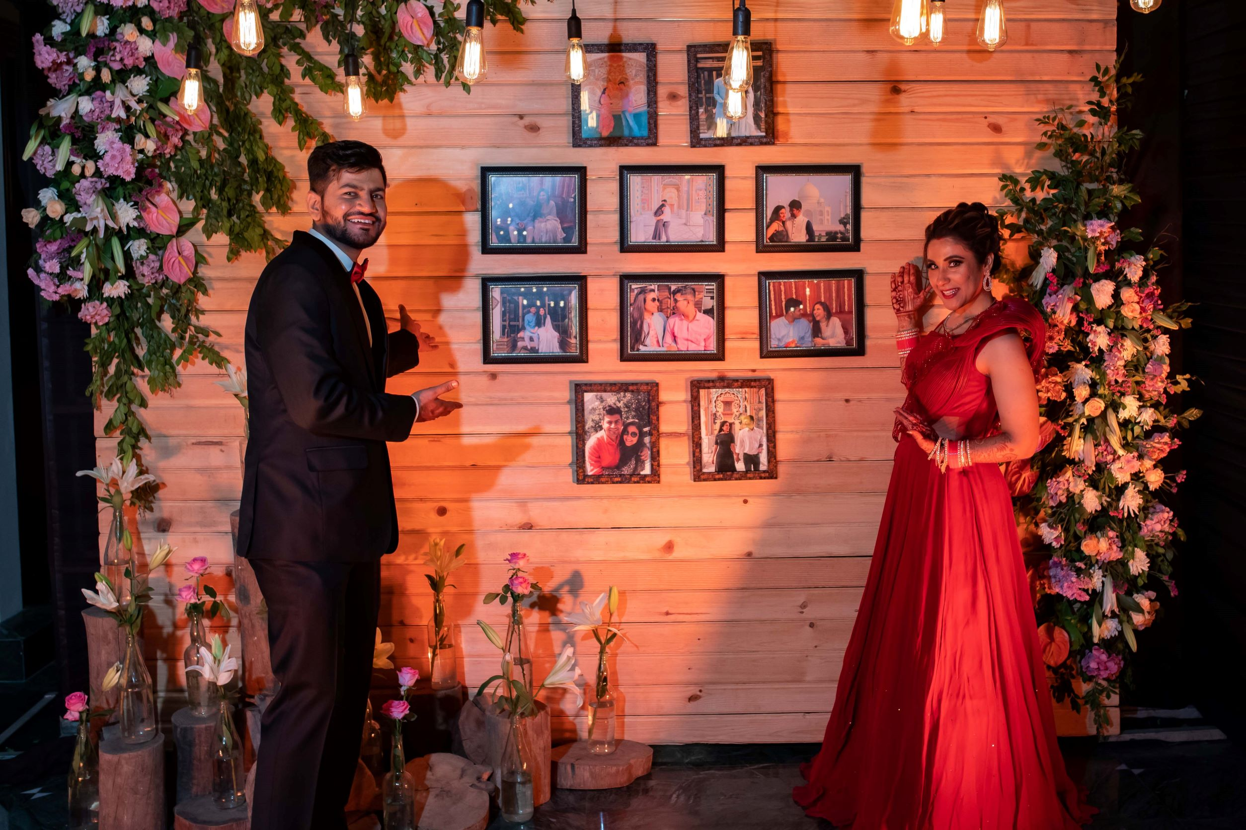 couple poses with their photowall