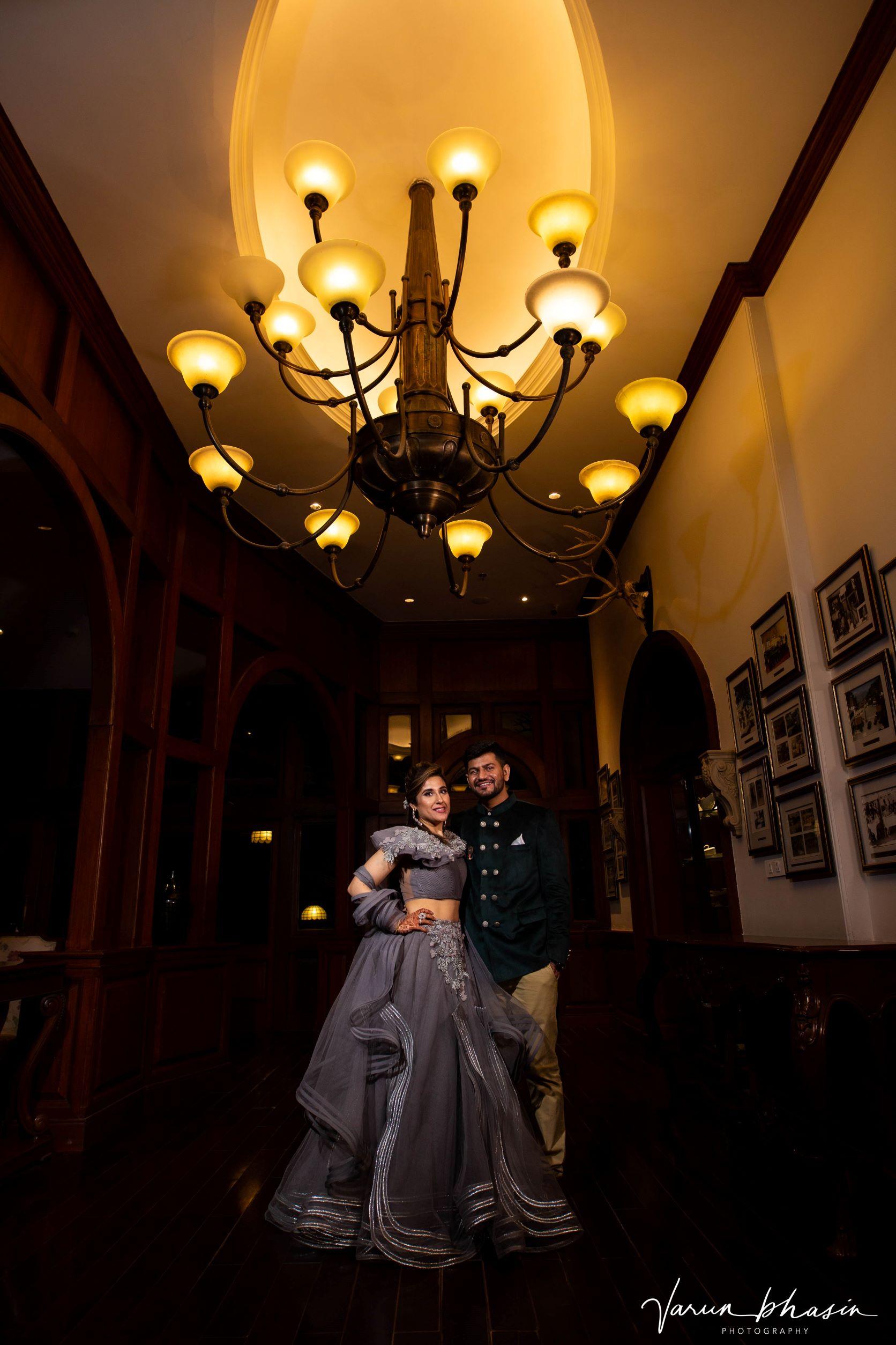 couple shot under a chandeliar