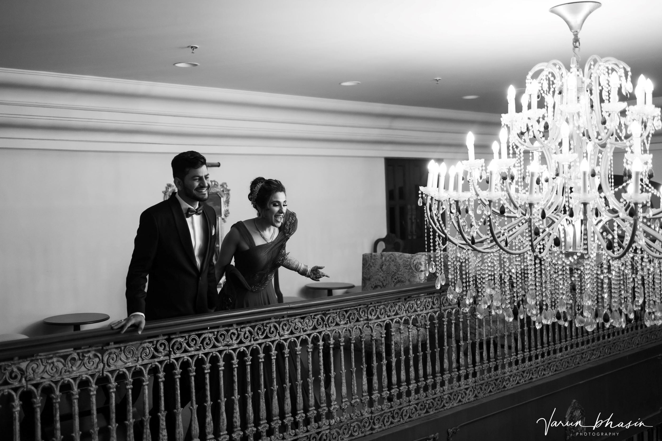 couple shot with a chandelier