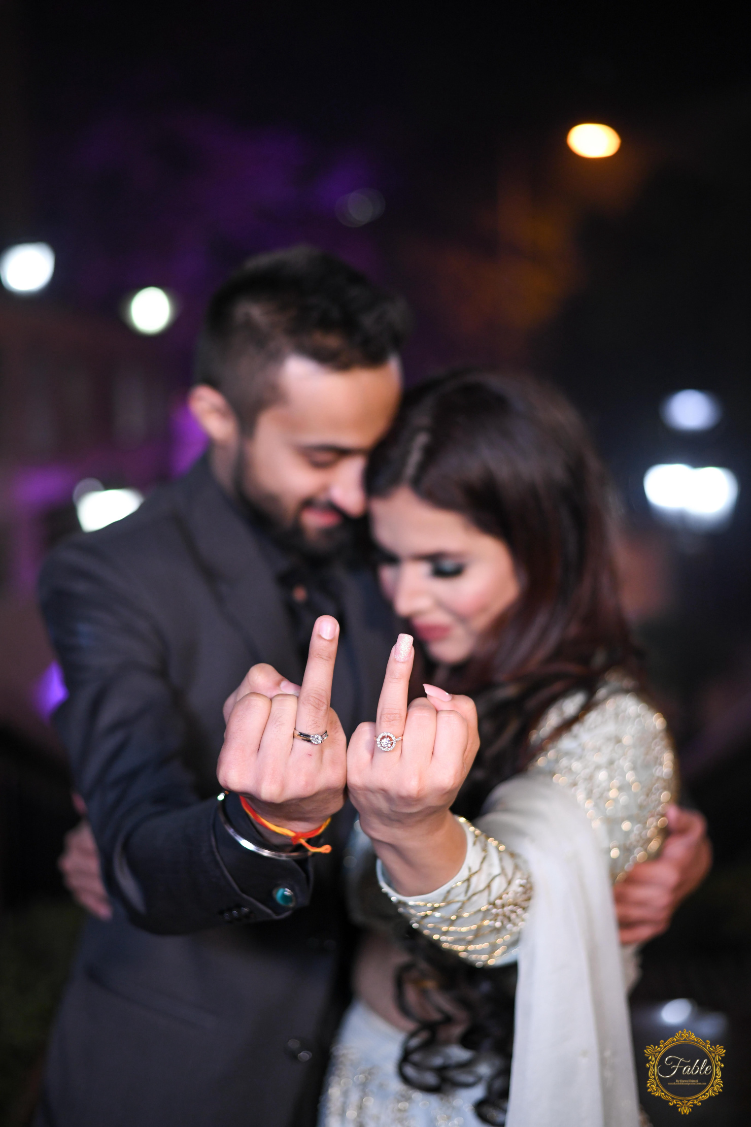 couple showing off their engagement rings