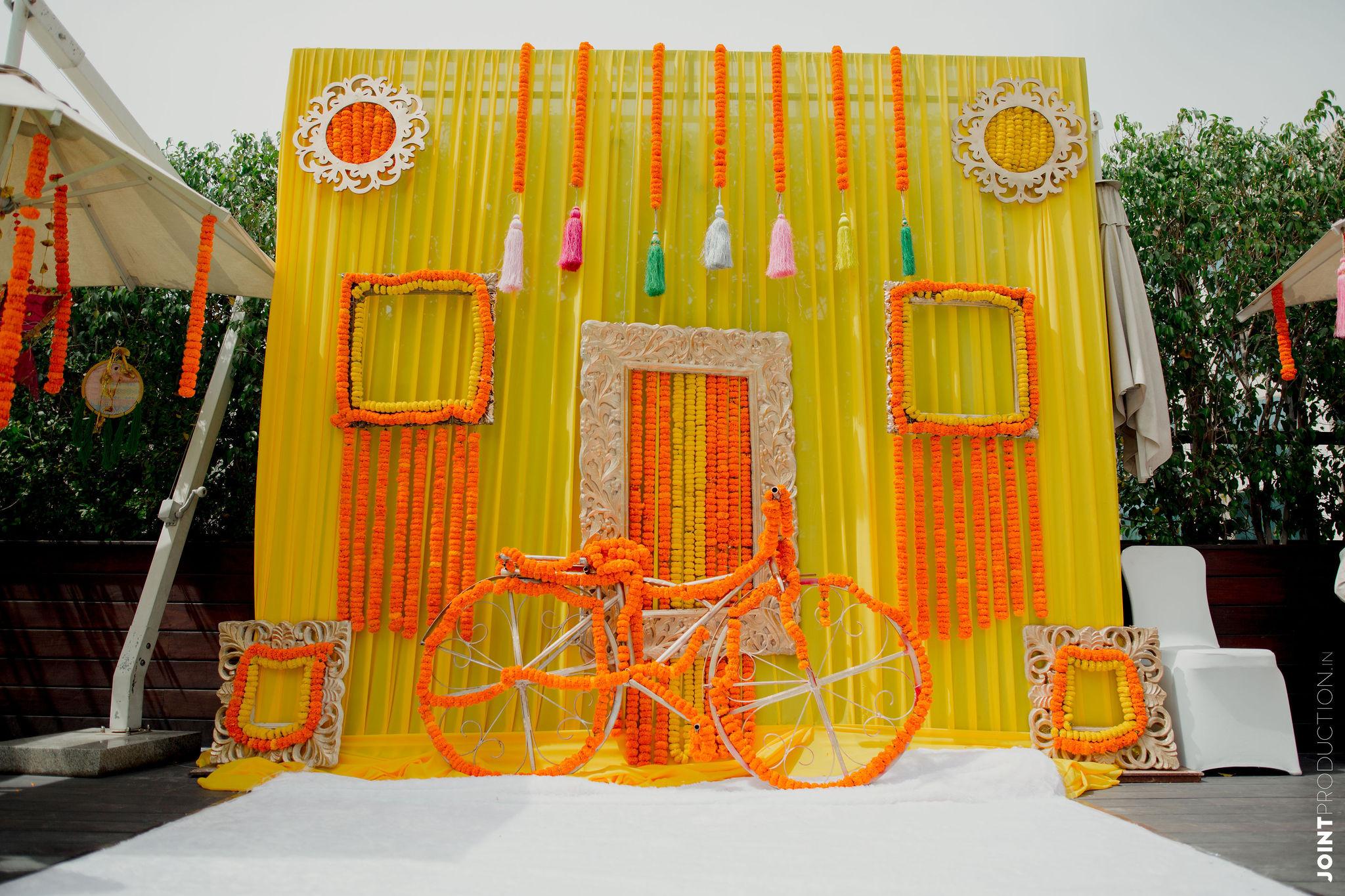 cycle and marigold decor for haldi