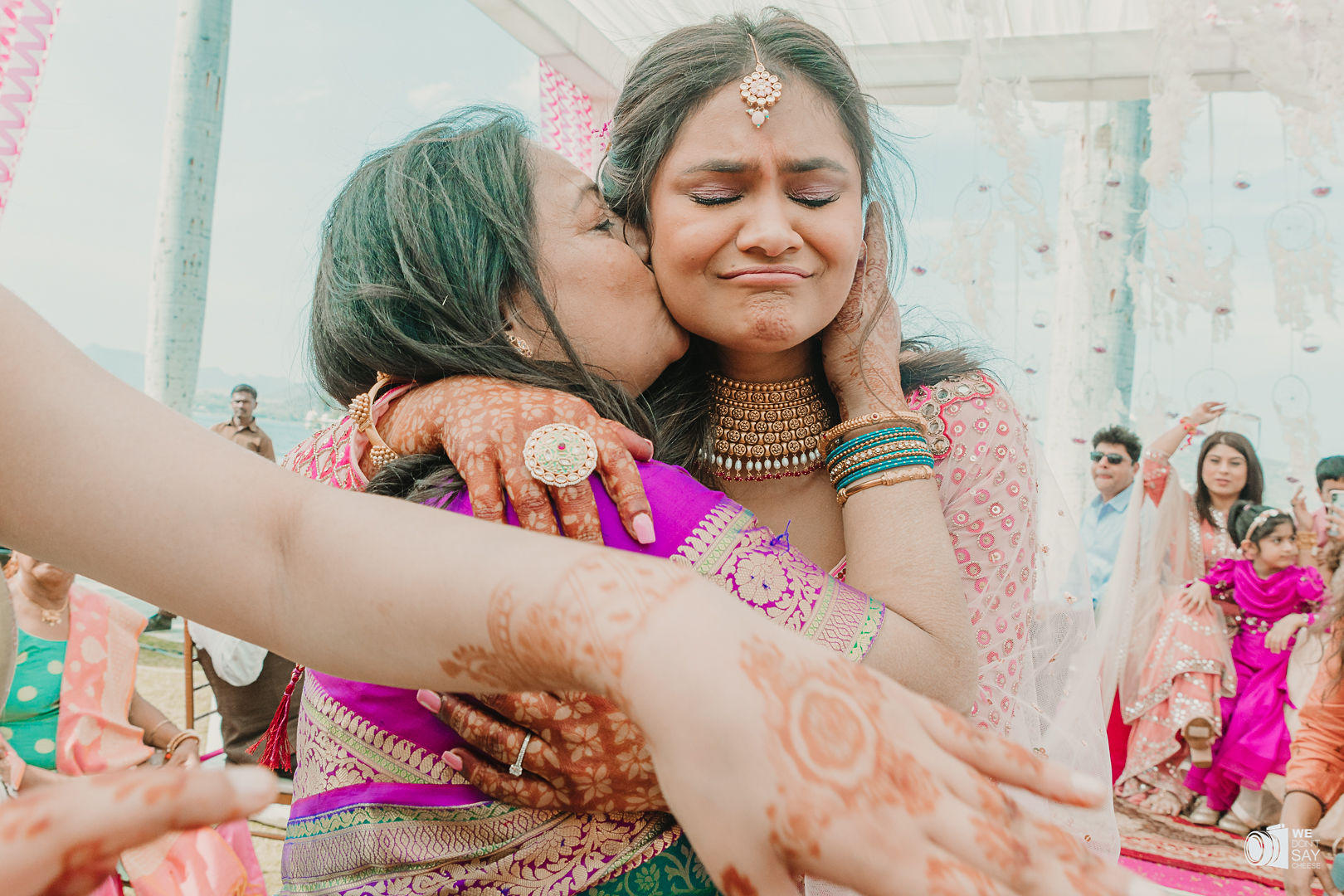 emotional shot of the bride with her mother