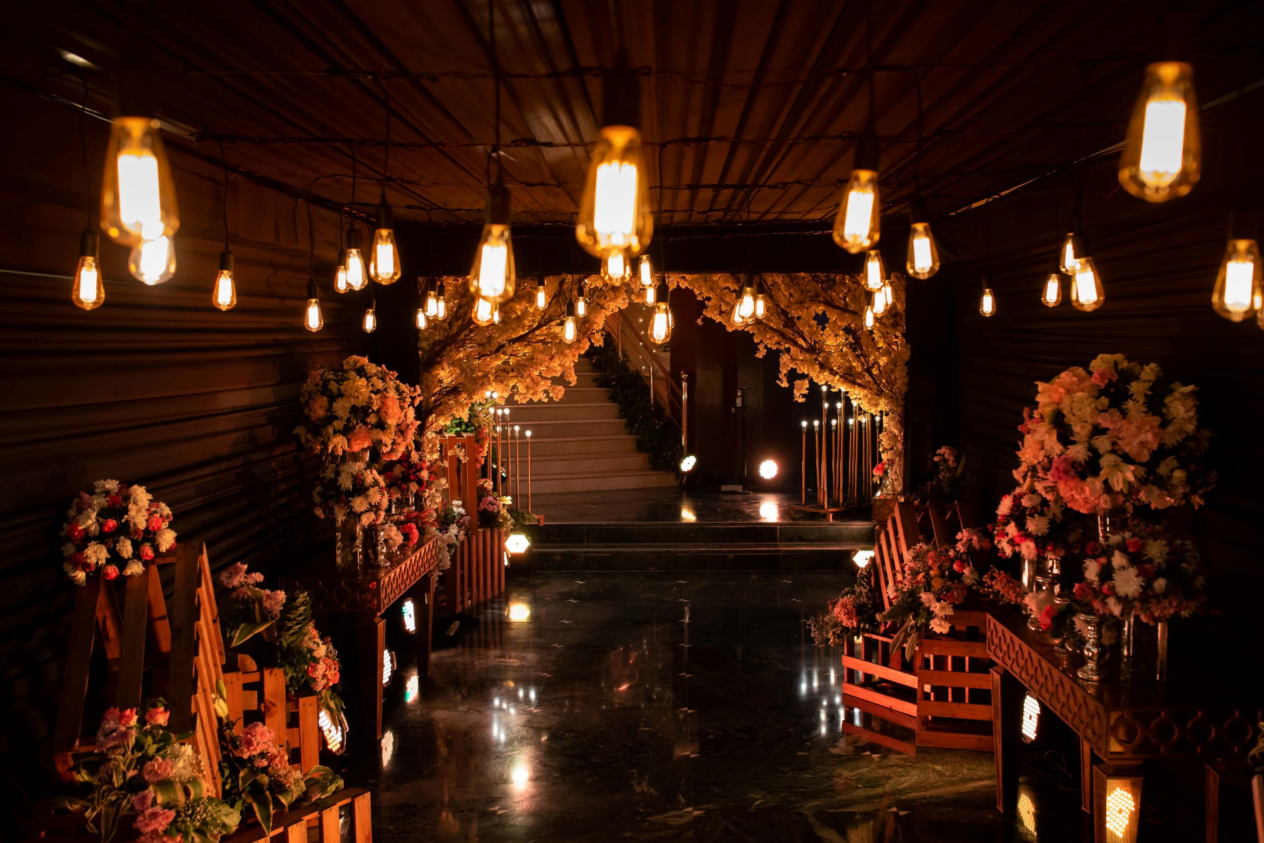 entrance decorated with lights and flowers