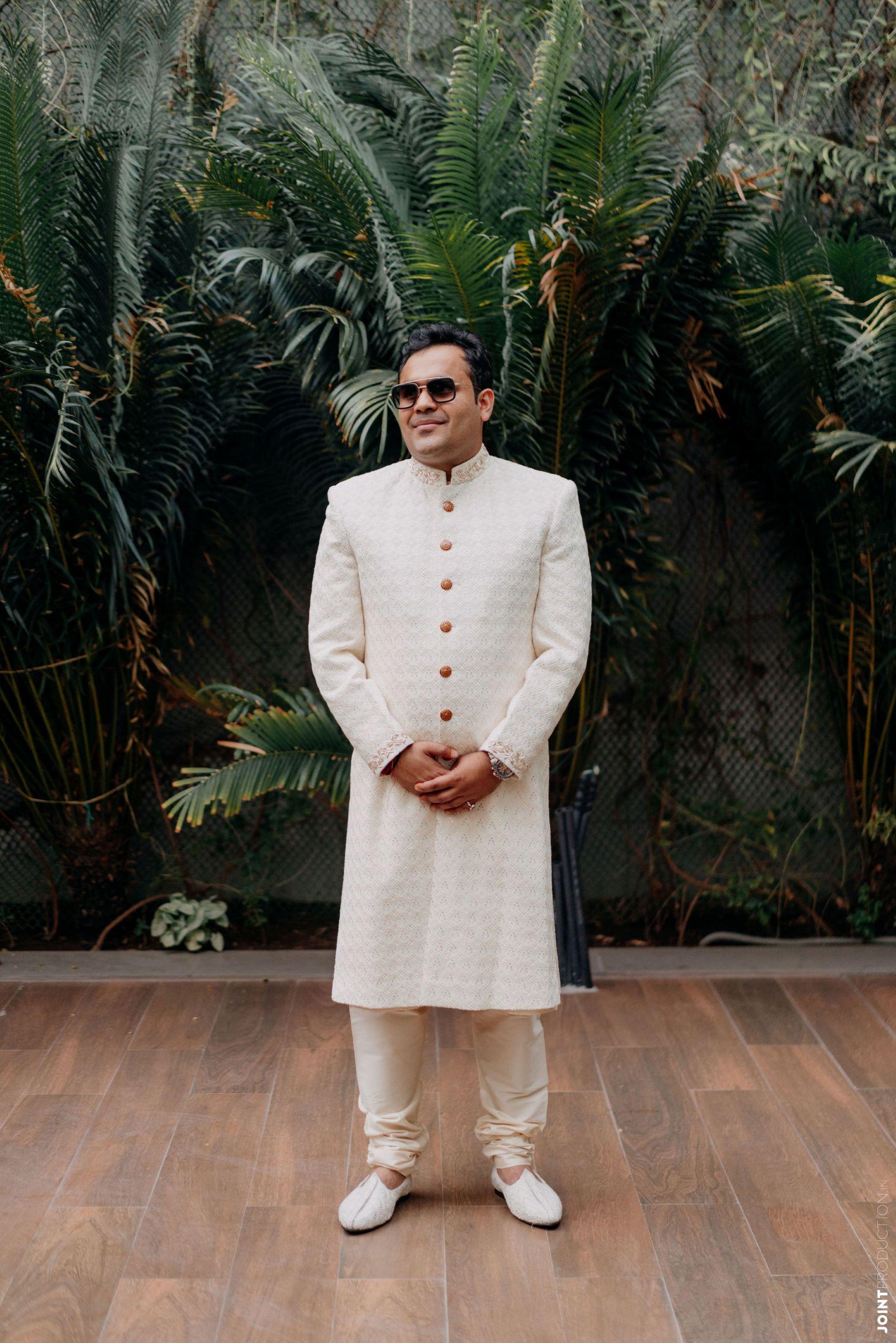 groom in off white sherwani