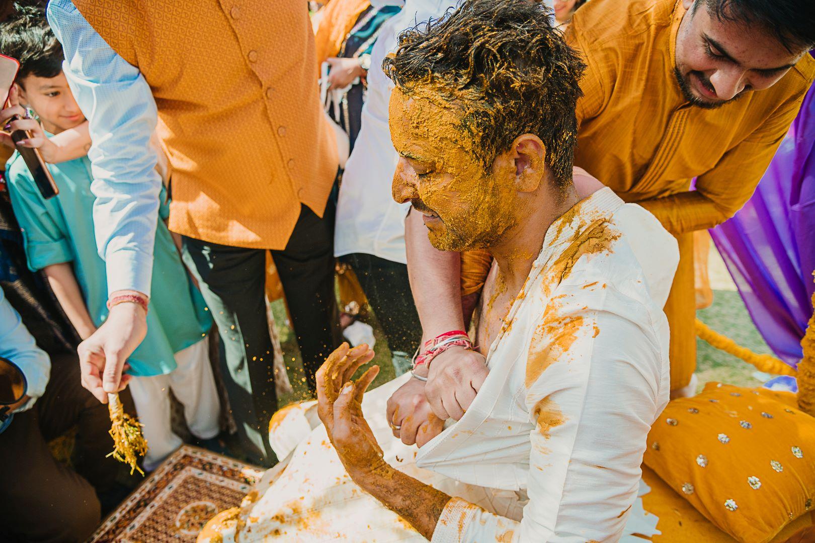 groom in white kurta for haldi