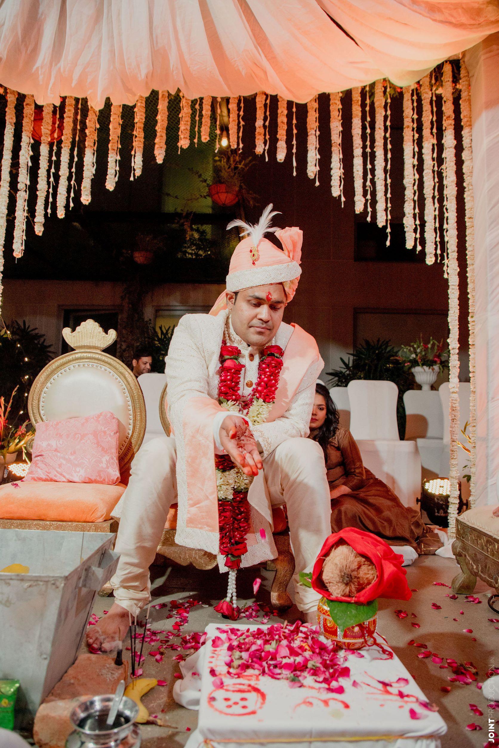 groom in white sherwani at his wedding