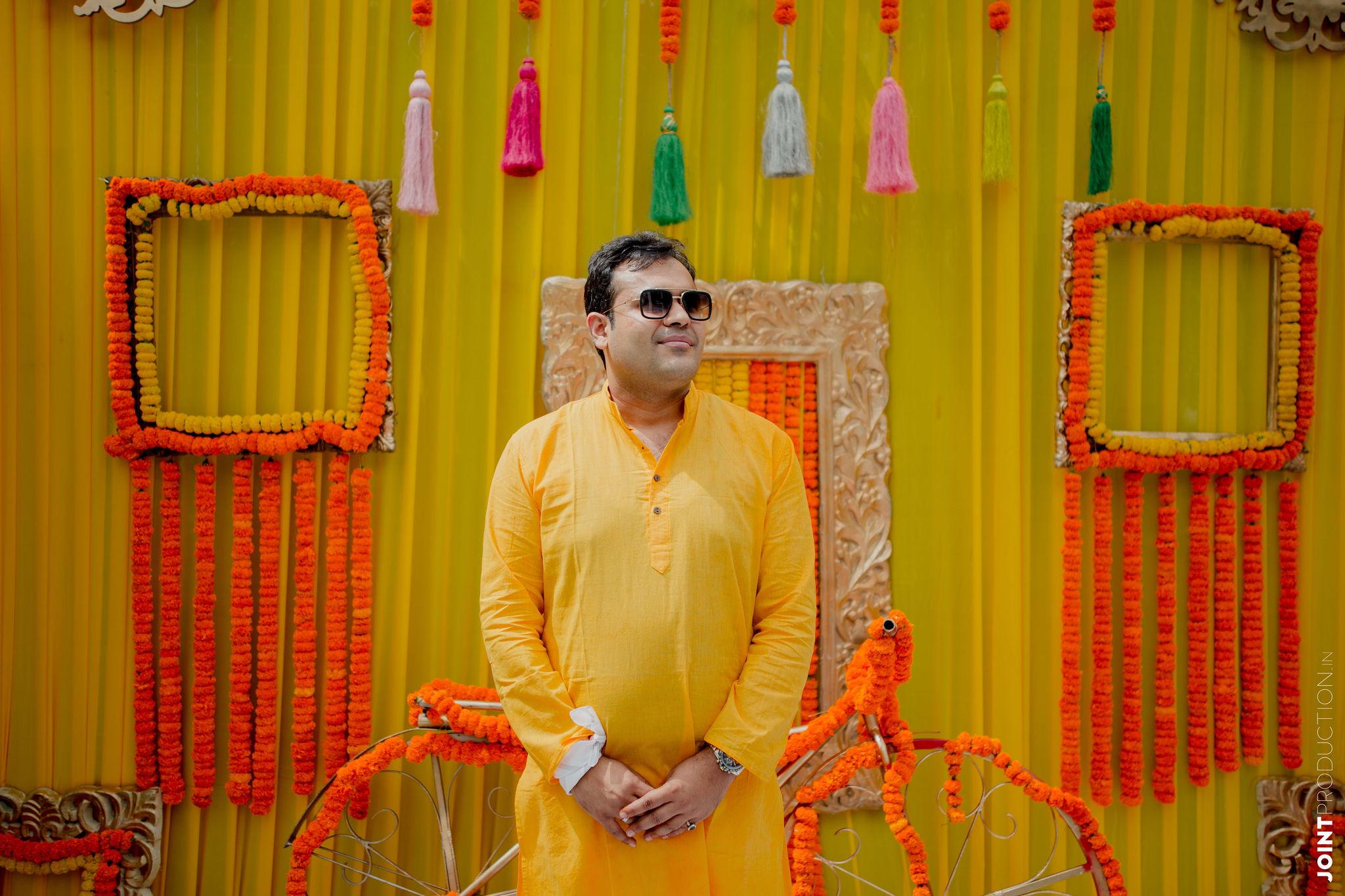 groom in yellow at his haldi