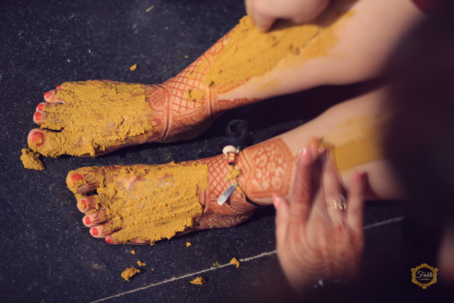 haldi on bride's feet