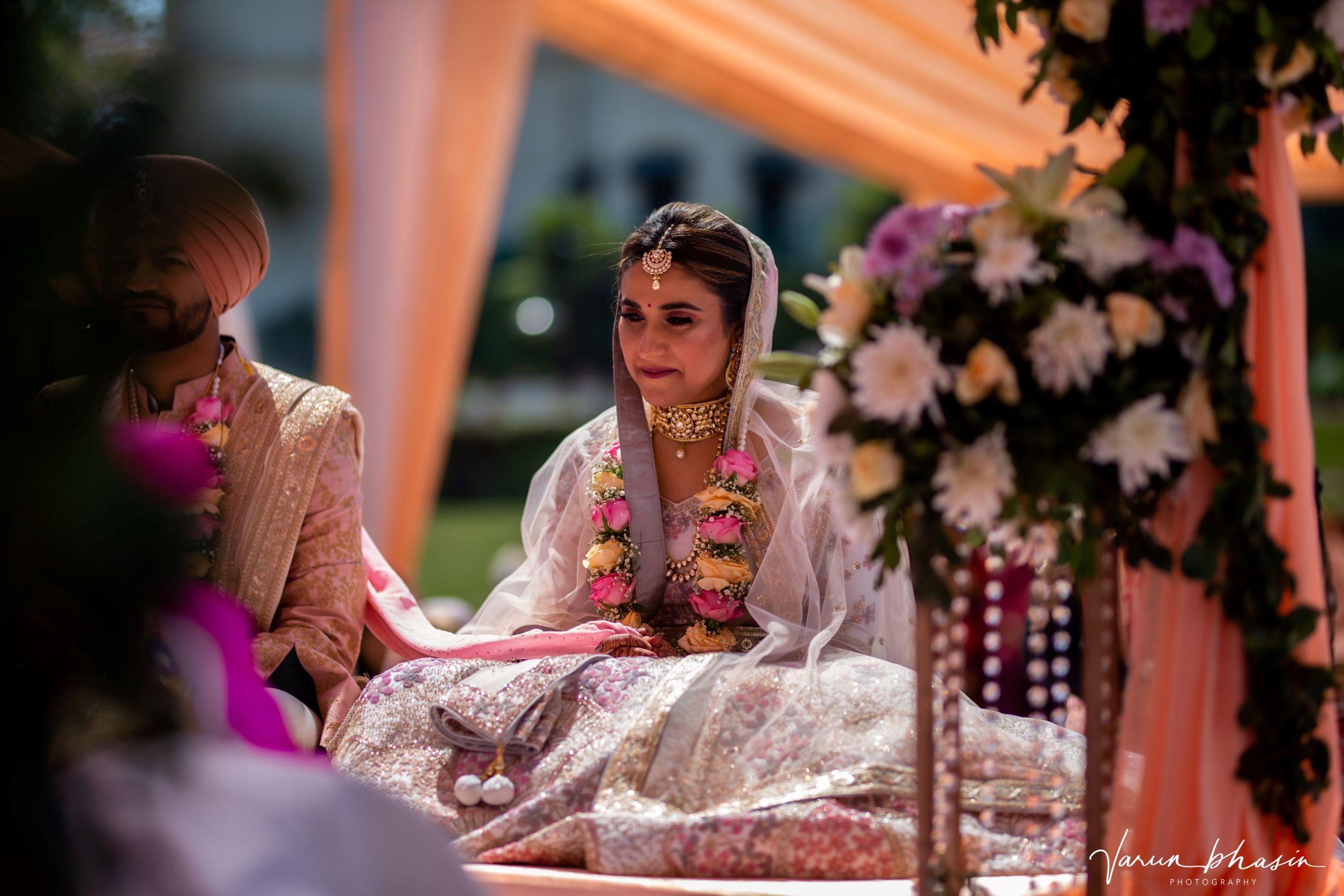 happy bride at her anand karaj