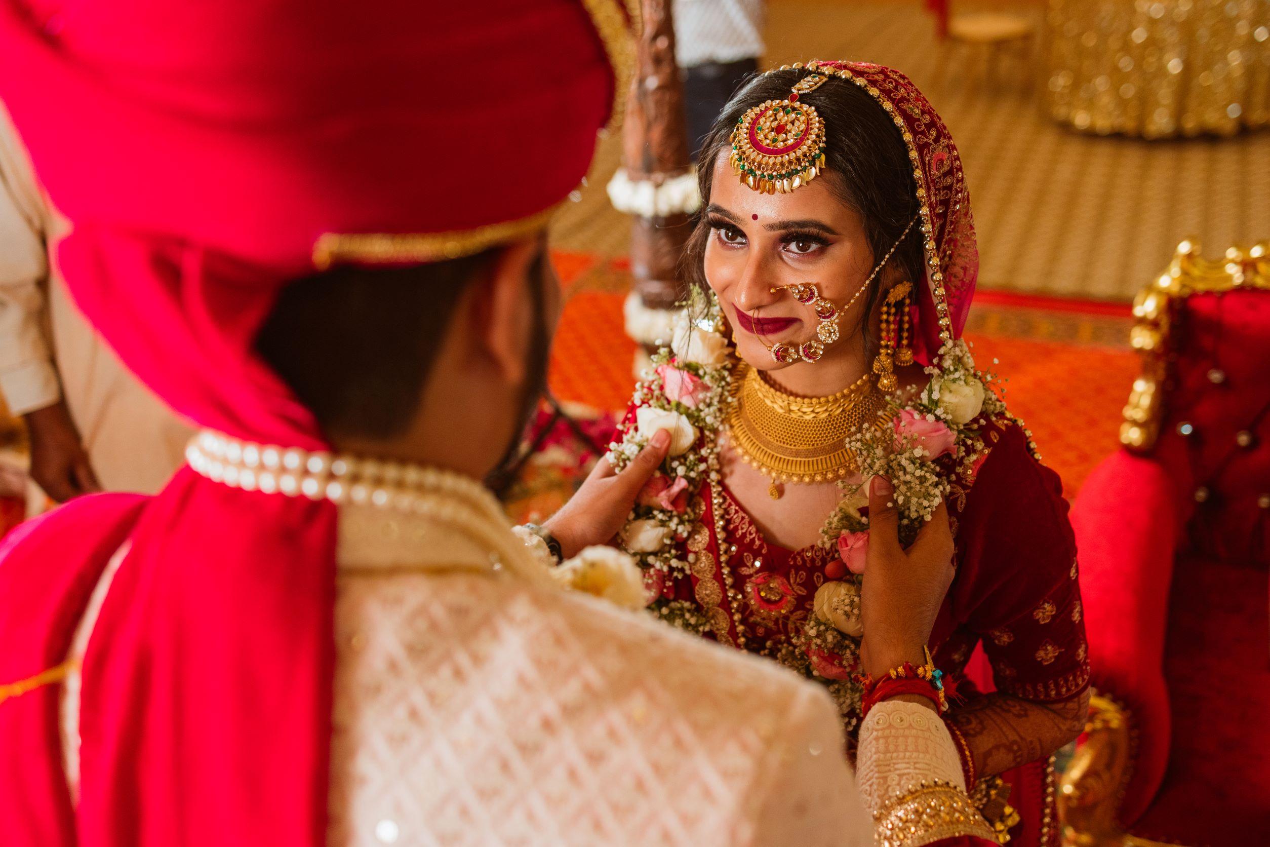 happy bride at her jaimala