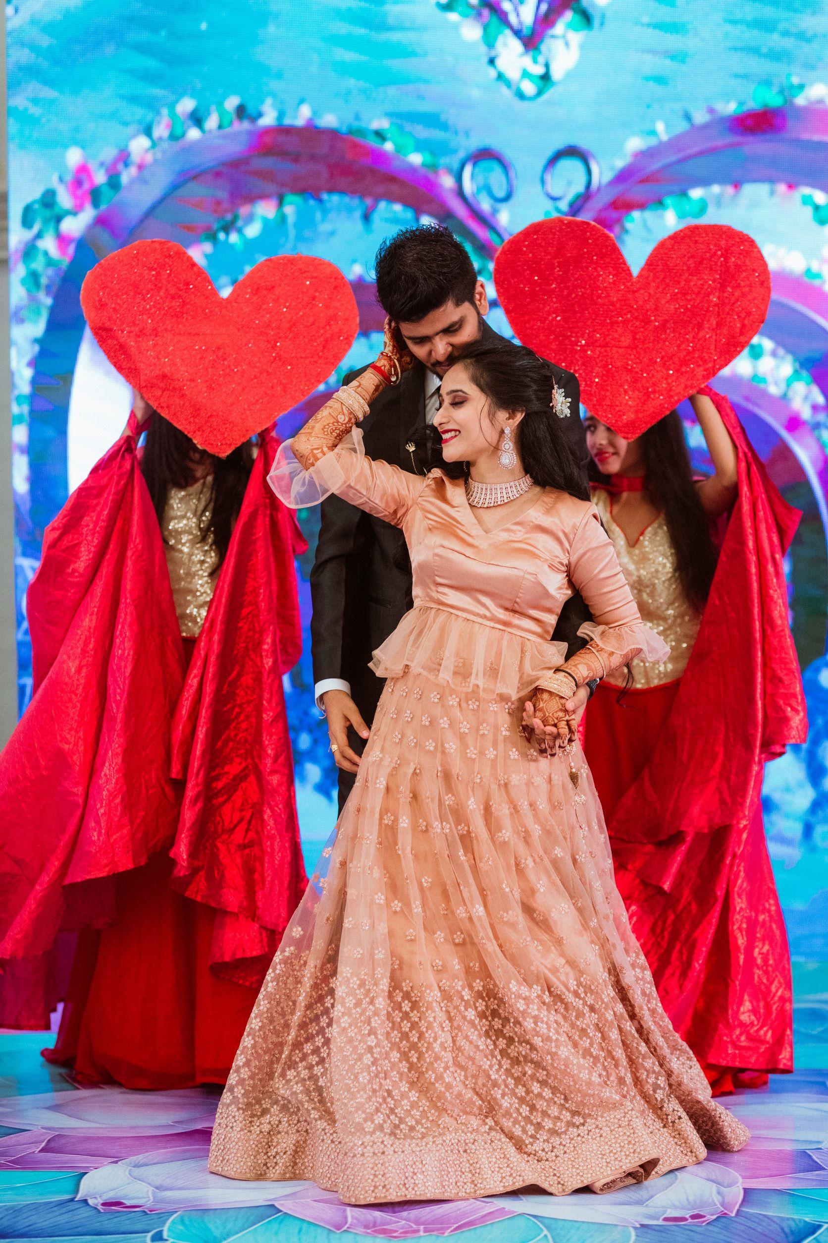 happy bride dances with her groom
