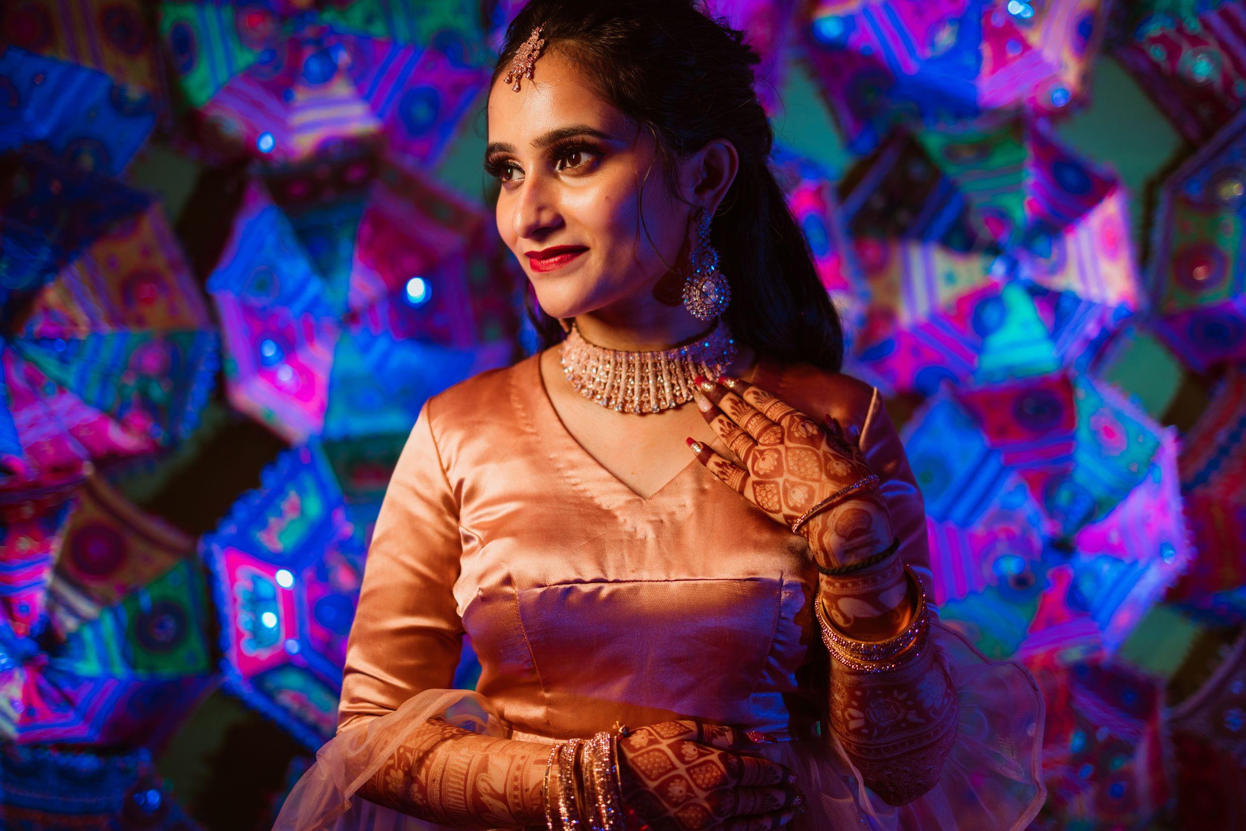 happy bride in gold bridal jewellery
