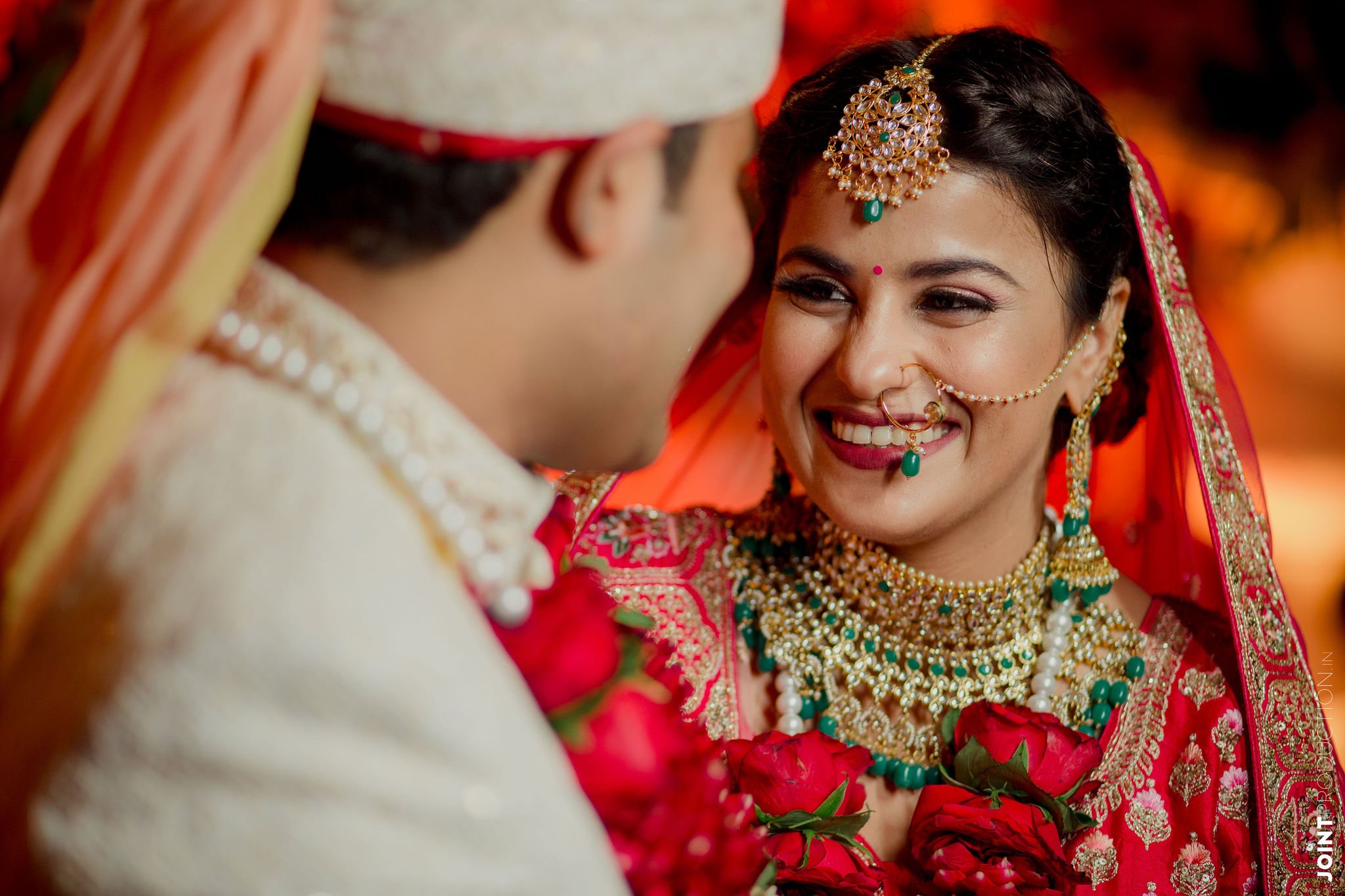 happy bride in natural bridal makeup and contrasting jewellery