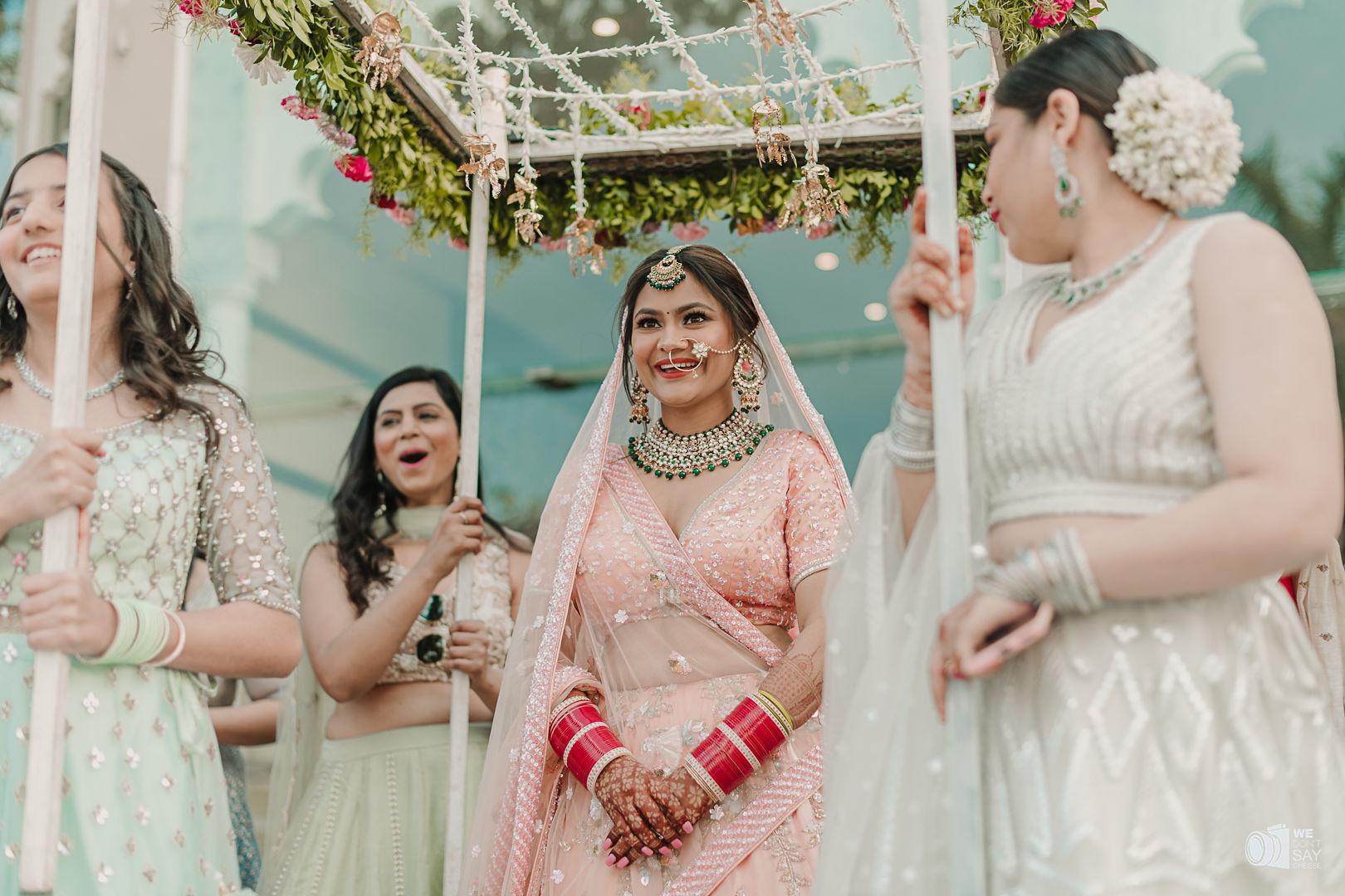 happy bride in peach bridal lehenga