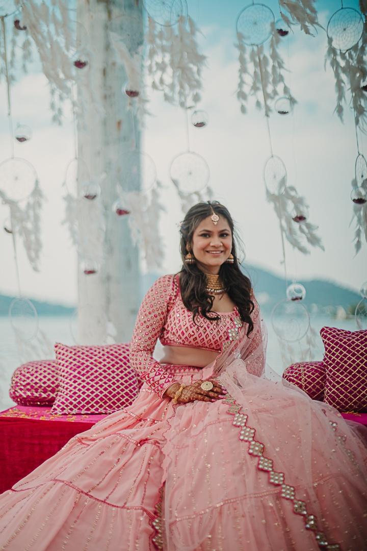 happy bride in pink lehenga