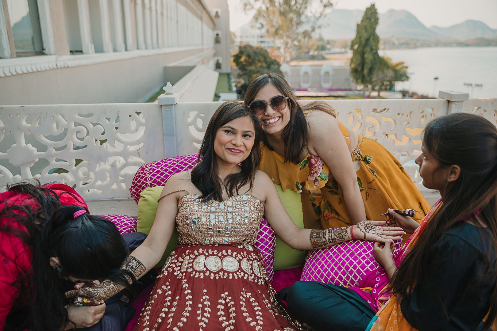 happy bride poses with her friend