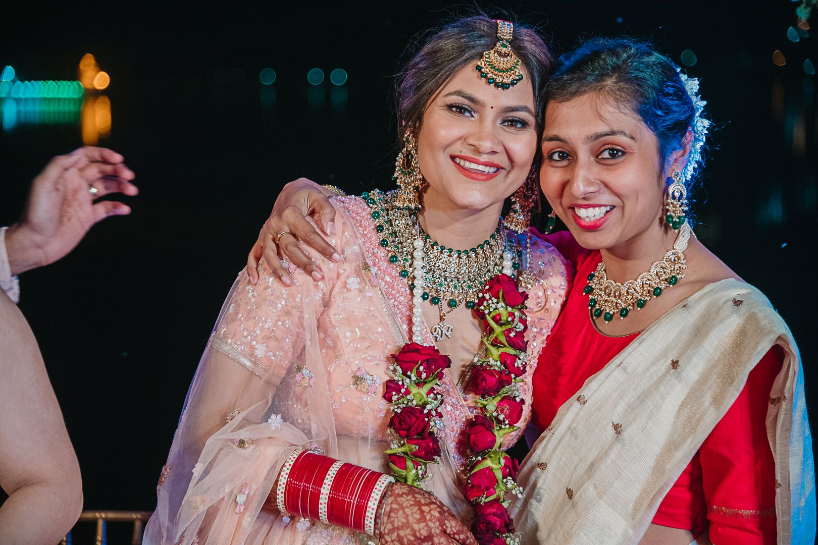 happy bride poses with her friends