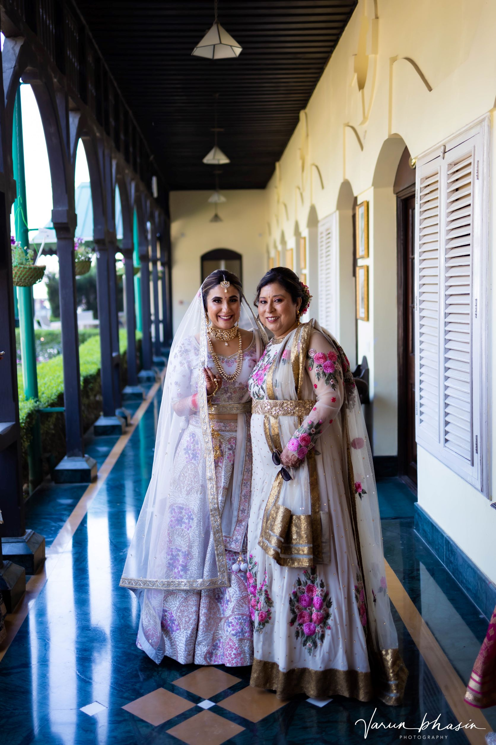 happy bride poses with her mother