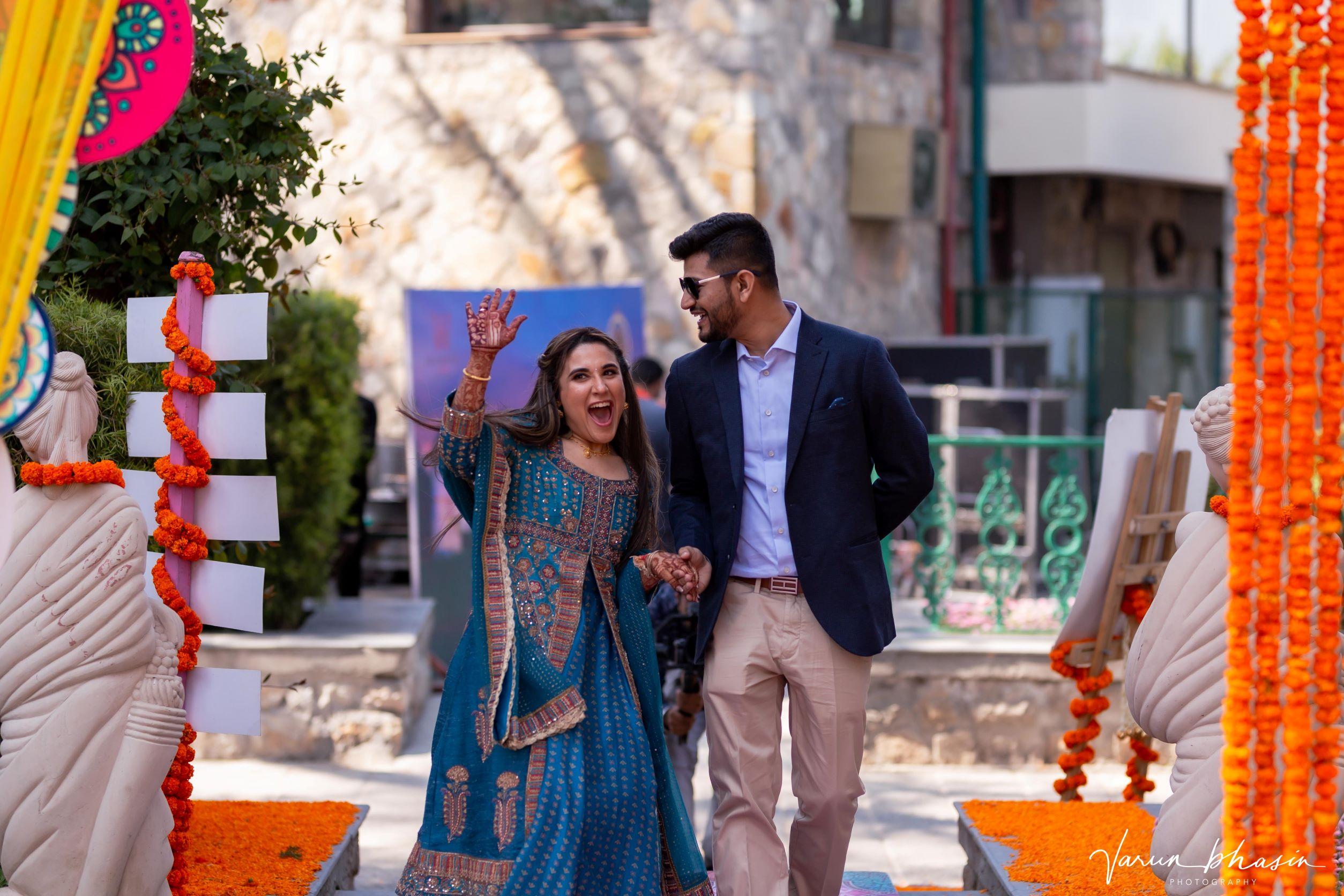 happy couple entering at their mehendi venue