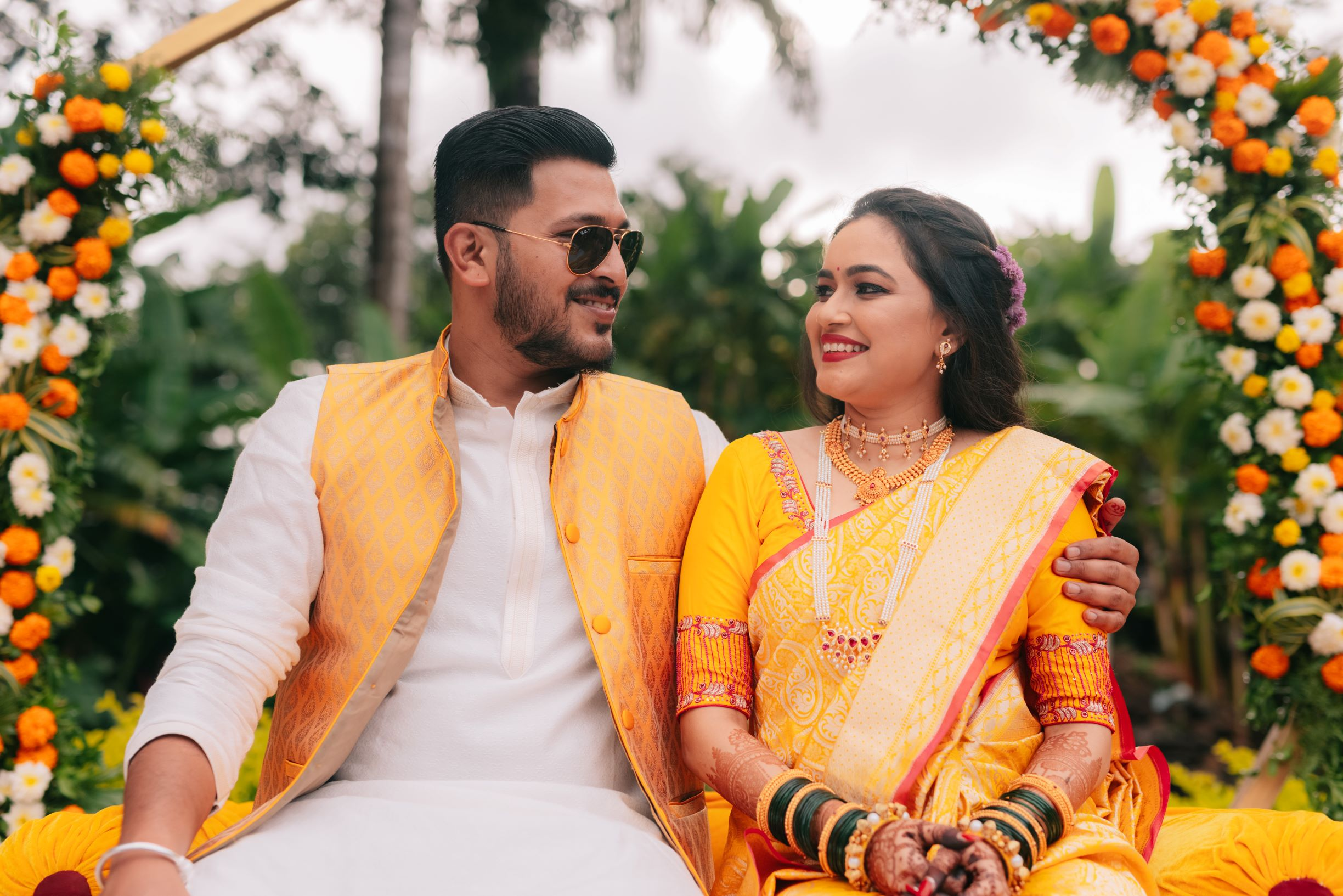 happy couple in yellow at their haldi
