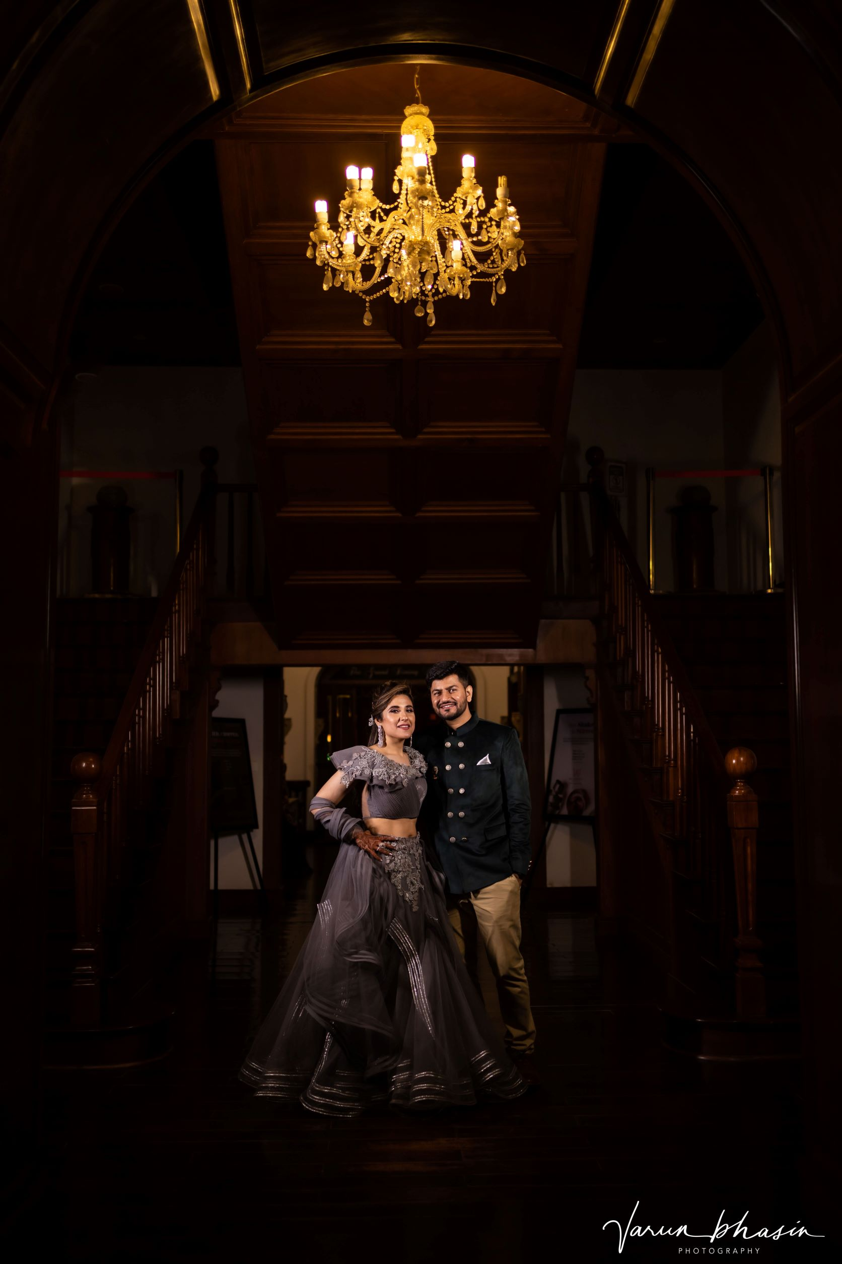 happy couple poses at their sangeet